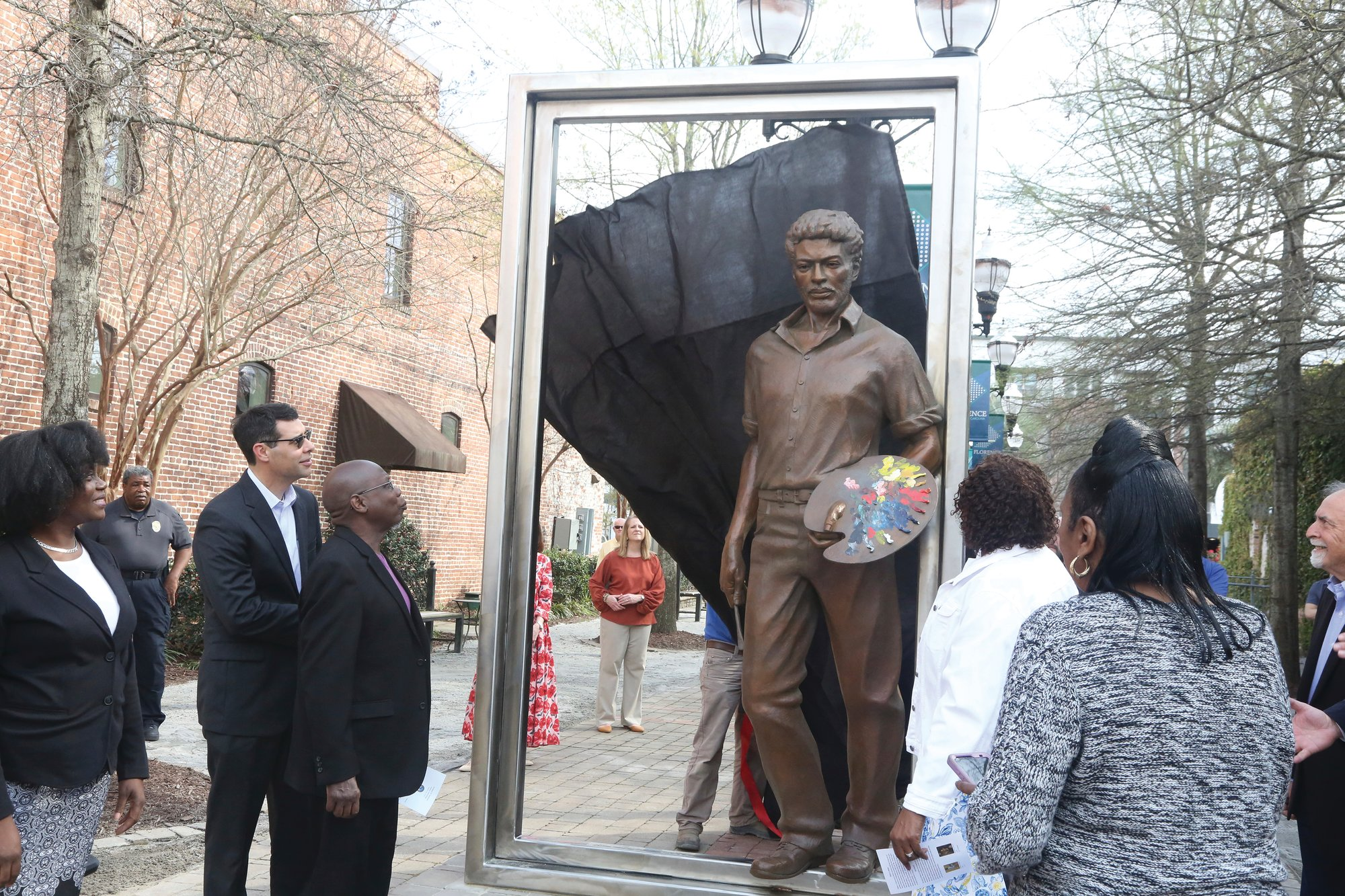 Matthew Christian / The Morning News via AP   The city of Florence unveils a statue of artist William H. Johnson in the West Evans Street Breezeway on March 18.