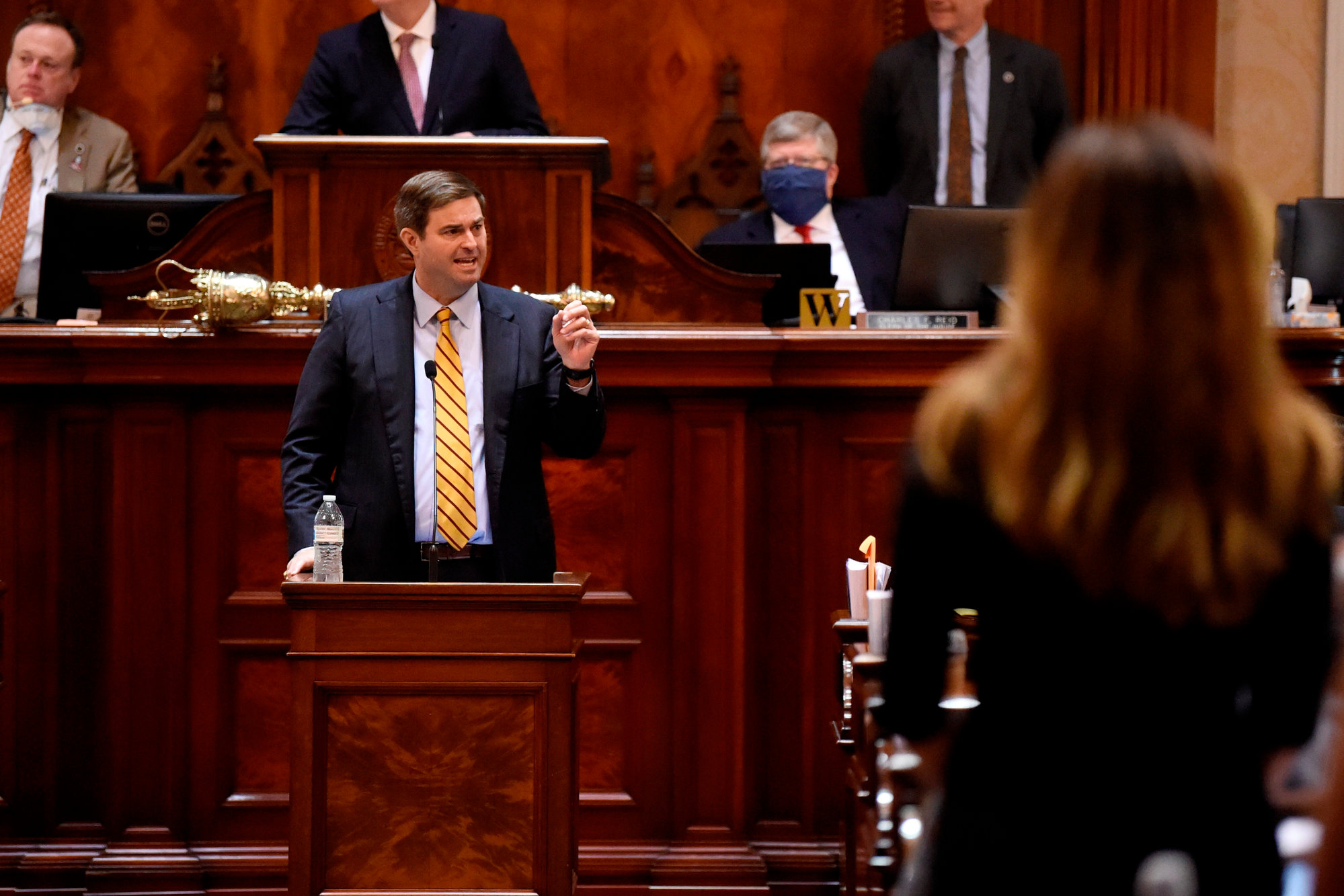 House Ways and Means Committee Chairman Murrell Smith, center, answers a question from state Rep. Nancy Mace, right, on the House floor during a special, one-day session of the South Carolina Legislature on Wednesday, April 8, 2020, in Columbia.