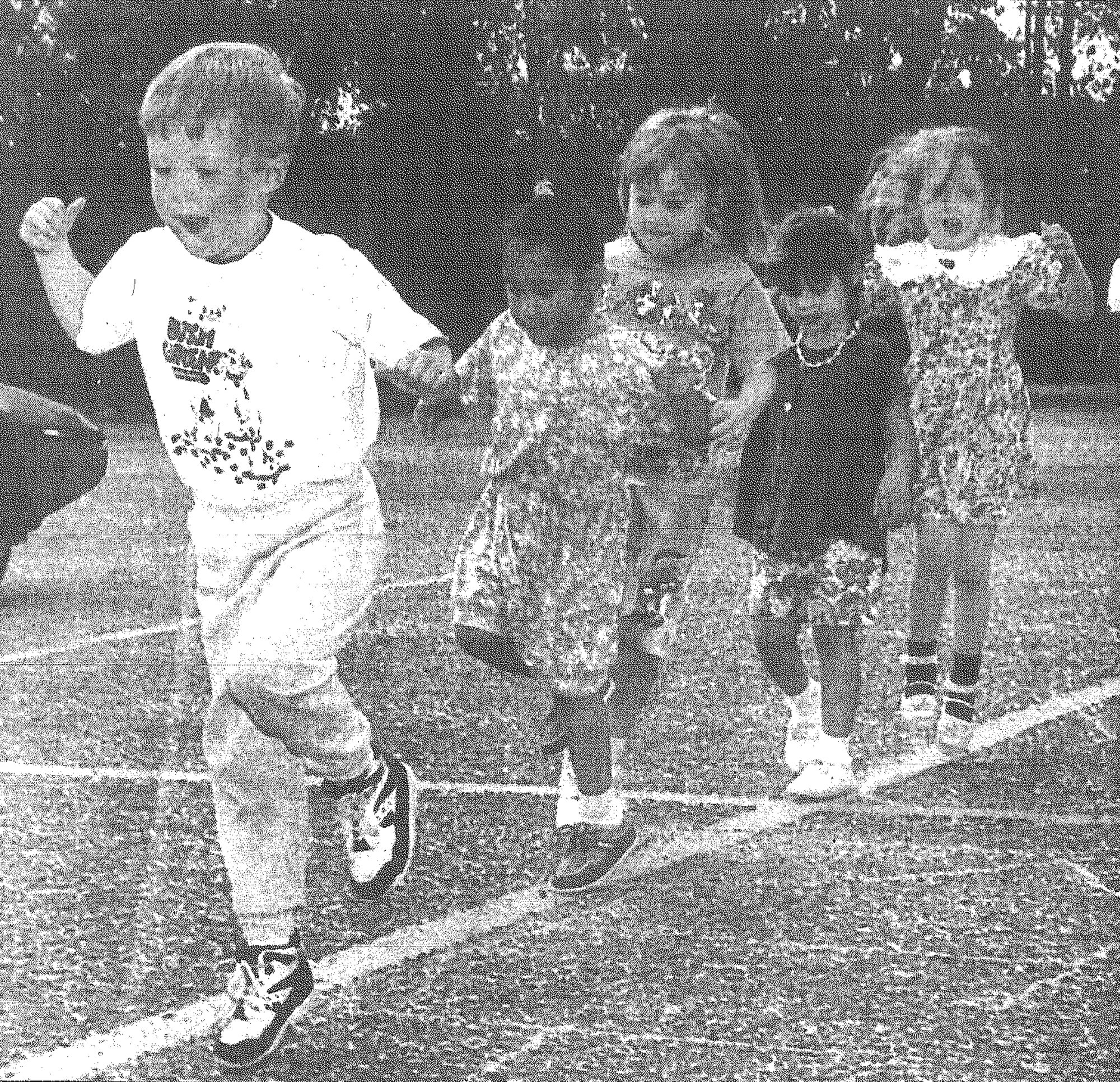 Twenty-eight children from Sumter's La Petite Academy skipped, hopped and walked backward in April 1995 to raise money for the Children's Miracle Network in the parking lot of the Piggly Wiggly on Pinewood Road. From left are Tyler Broome, 4; Regina Malloy, 4; Taylor Davids, 5; Jennifer Ouellette, 4; and Jacklyn MacLean, 5.