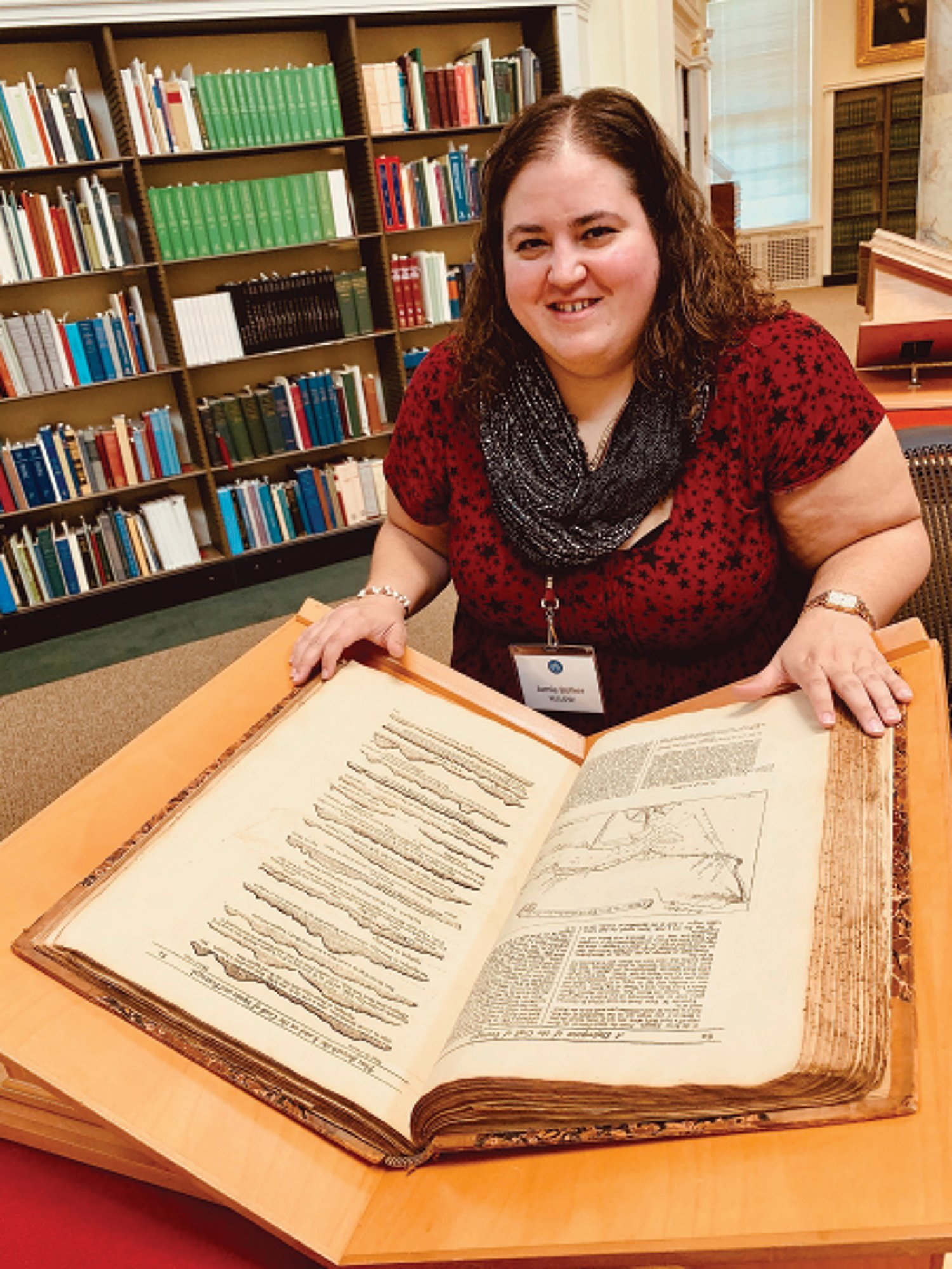 Ben Bascom via AP   Jamie Bolker is seen doing research at the American Antiquarian Society in Worcester, Massachusetts.  When Bolker started teaching composition at MacMurray College in January 2020, she felt like she'd won the lottery. In March, she learned it was permanently closing.