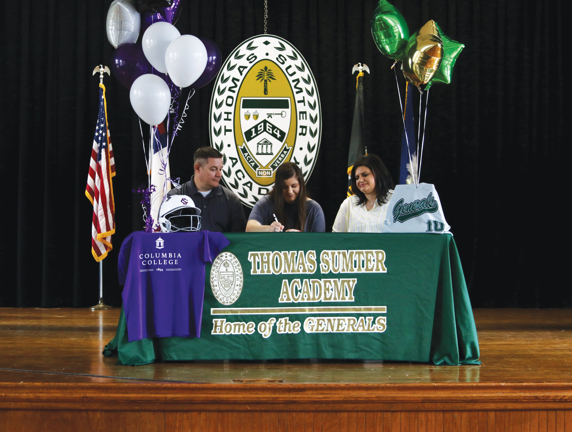 Thomas Sumter's Ellie Hunter, center, was joined by her parents, Nolan, left, and Mandi as she signed to play softball at Columbia College.