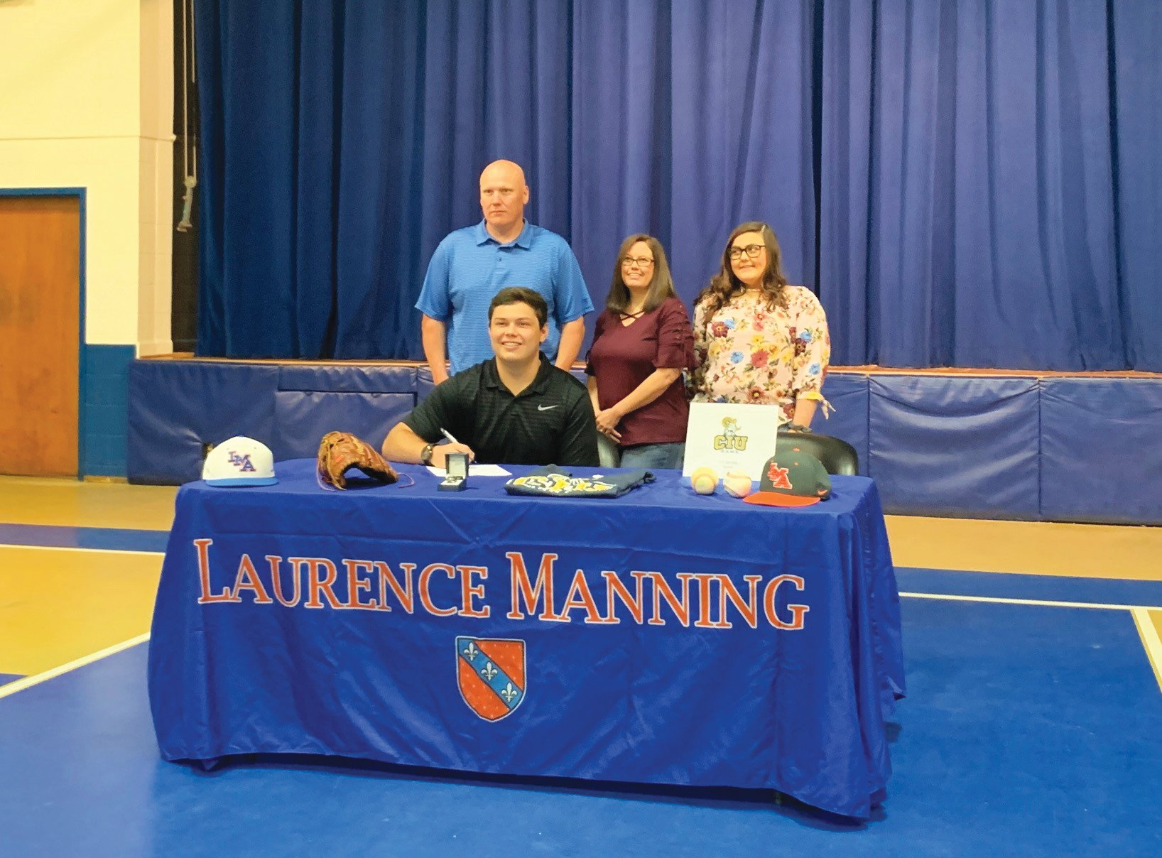 Laurence Manning Academy's JT Stanley, seated, signed to play college baseball with Columbia International University on Thursday. Standing behind Stanley, left to right, are his father Jason, mother Amanda and sister Emily.