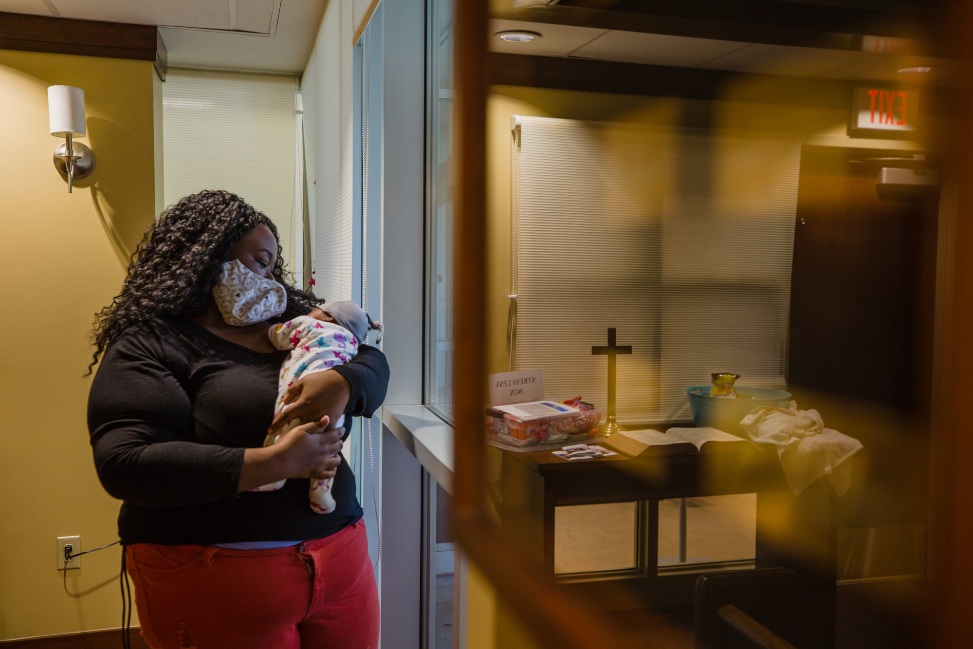 Shaquilla James holds her newborn daughter, Aubree. James survived COVID-19 while pregnant and giving birth to Aubree.