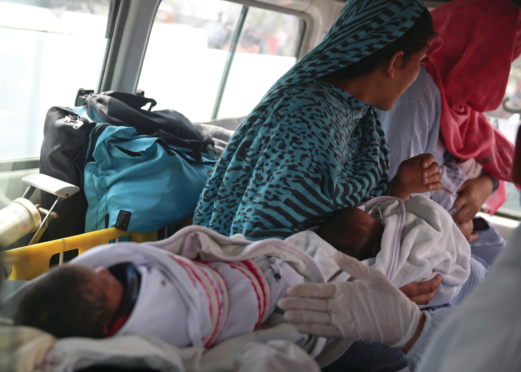 Babies are taken away by ambulance after gunmen attacked a maternity hospital, in Kabul, Afghanistan, Tuesday, May 12, 2020.