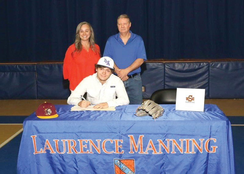 Laurence Manning Academy's Aaron Carlton, seated, has signed to play baseball with the University of South Carolina Salkehatchie. Standing from left to right are his mother, Ann, and father, Richard.
