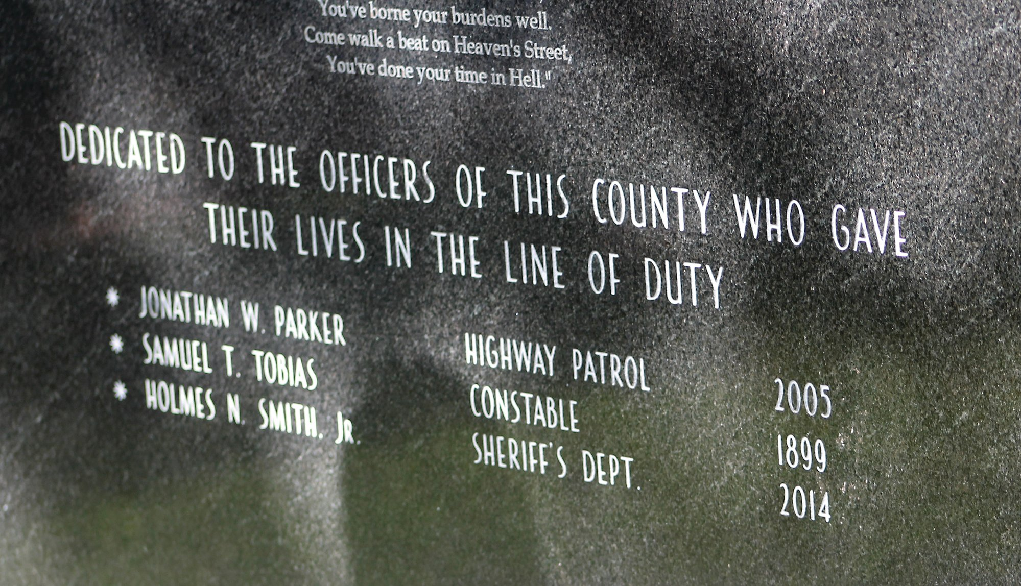 The Clarendon County Law Enforcement Officers' Memorial rests under towering trees on the Mill Street side of the Clarendon County Courthouse.  Names of Clarendon County law enforcement officers who died in the line of duty are engraved on both sides of the monument. On the courthouse side of the monument, the name of the first documented death in Clarendon County is engraved above the most recent death.  Constable Samuel T. Tobias died in 1899. Clarendon County Sheriff's Office Investigator Holmes N. Smith Jr. died in 2014.