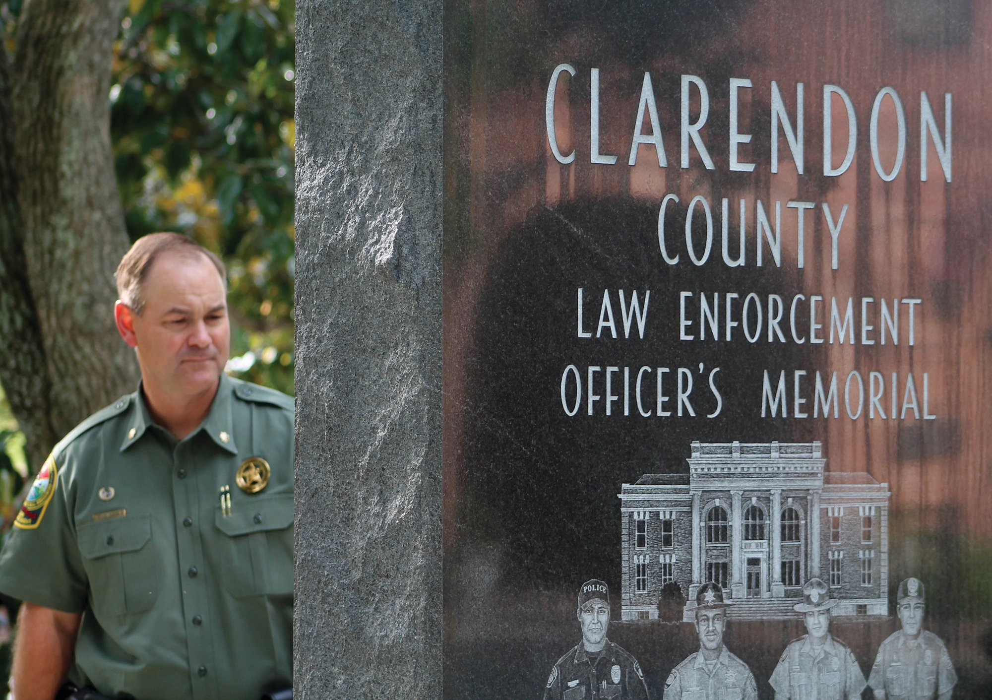 Maj. Billy Downer with the South Carolina Department of Natural Resources remembers many of the officers whose names are engraved on the Clarendon County Law Enforcement Officers' Memorial. Downer, along with fellow officers from various agencies, made possible the memorial that rests on the west side on the Clarendon County Courthouse grounds.