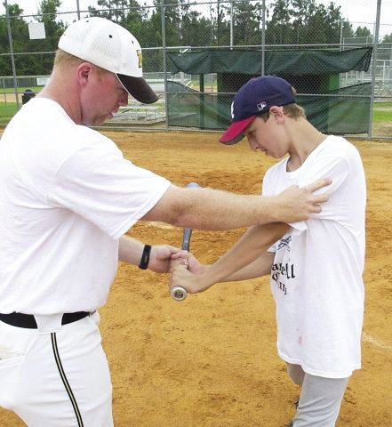 Frankie Ward, left, is shown working with a player during his time as the baseball head coach at Manning High School in 2006 and 2007. Ward is leaving his post as the athletic director at Lakewood for his second baseball head coaching job, this time at Lugoff-Elgin.