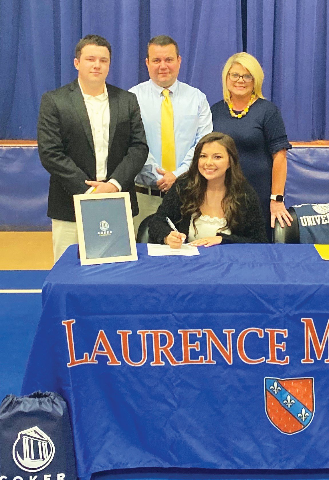 Laurence Manning Academy's Katherine Matthews, seated, has signed to play tennis with Coker College. Standing from left to right are her brother Dylan, father Brad and stepmother Anita.