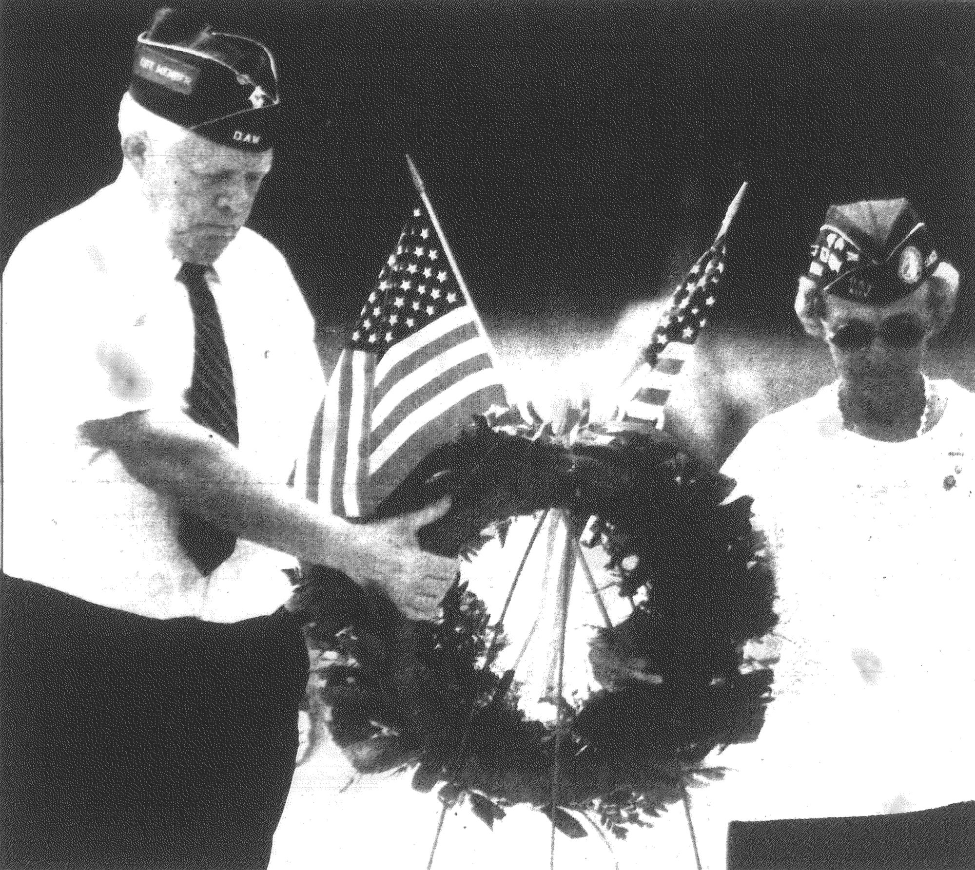 Disabled American Veterans Commander Joseph E. Barwick and Gisele Forest, a DAV auxiliary member, place a wreath at Evergreen Cemetery during a Memorial Day ceremony in 1991 in honor of those from Sumter County who gave their lives.