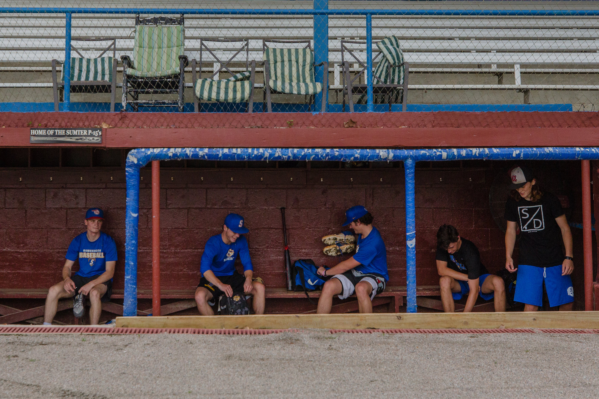 Members of the P15s take a break during their first practice following the cancellation of the American Legion season.