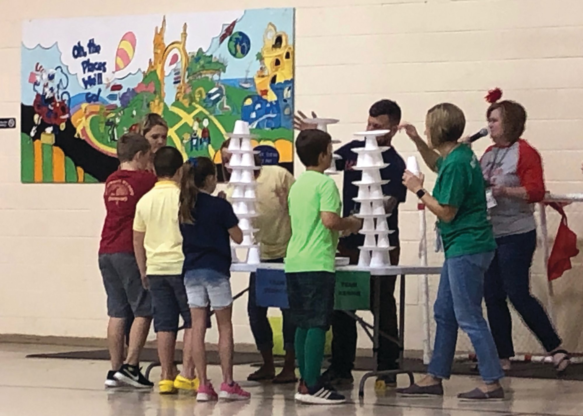 Students compete in building a structure from foam cups.