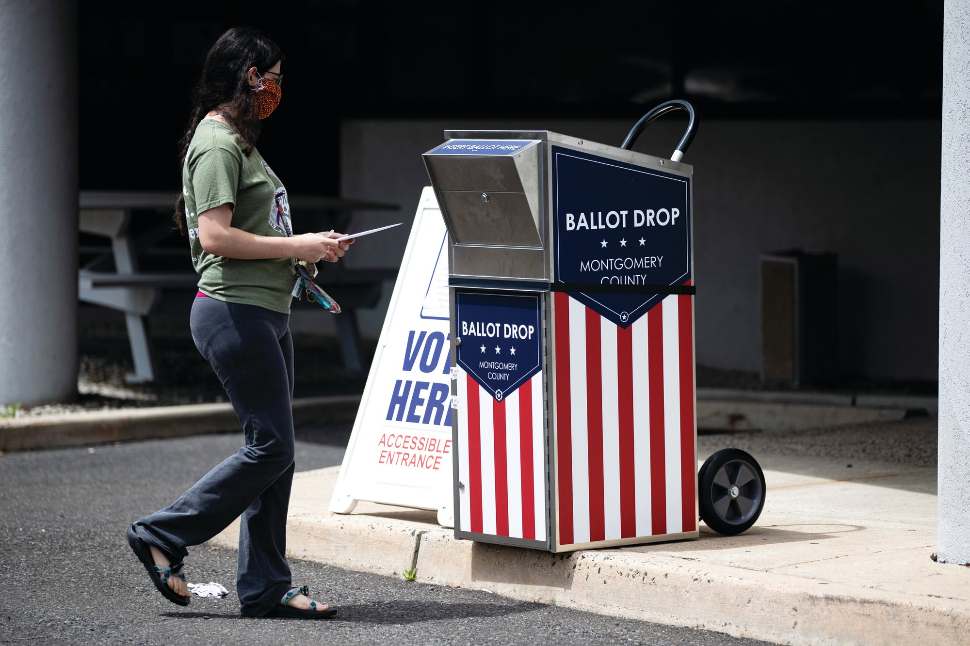 A voter drops off a mail-in ballot prior to the primary election in Willow Grove, Pennsylvania, on May 27.