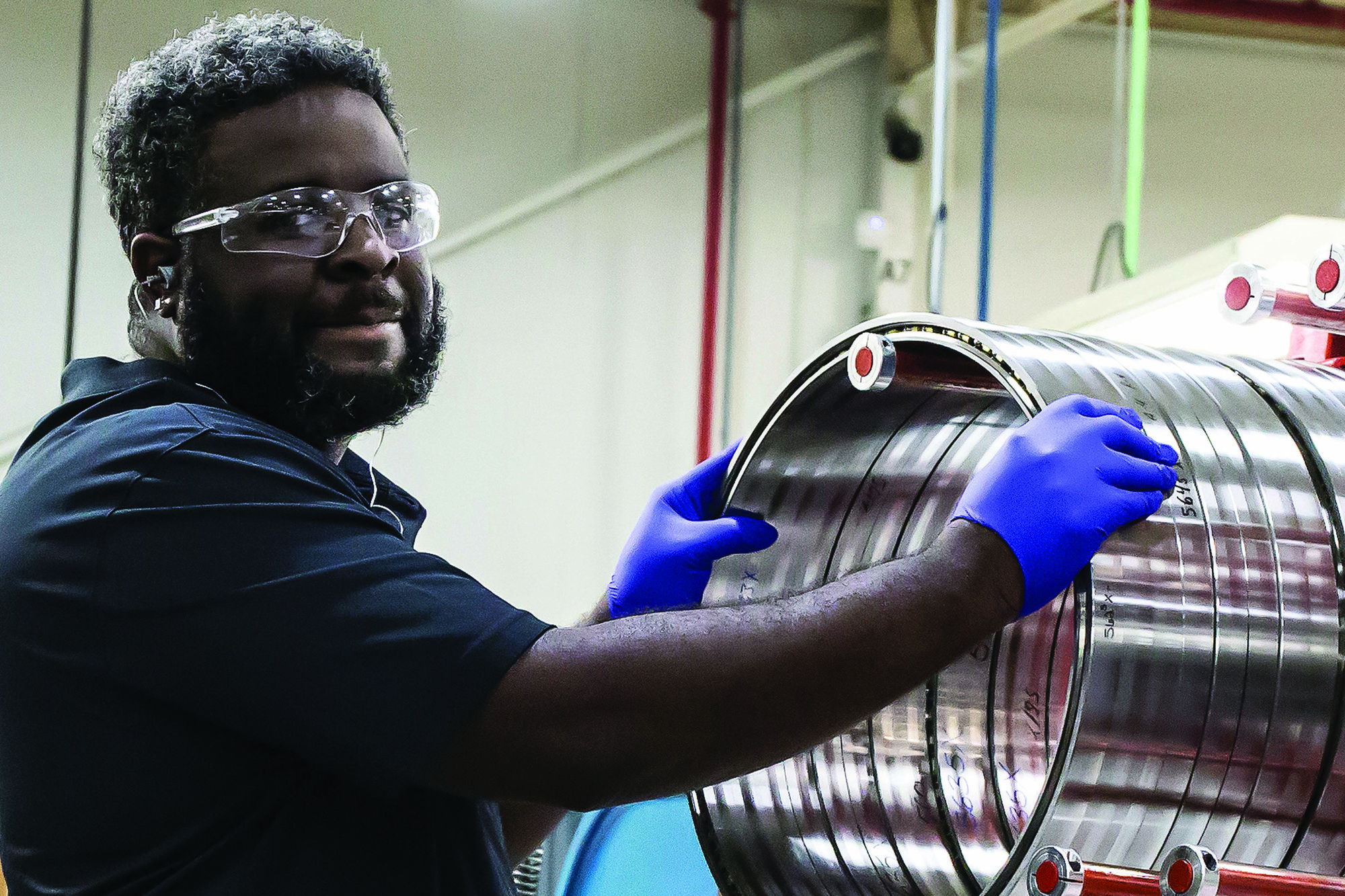 An SKF Sumter manufacturing employee works at the bearing plant in Live Oak Industrial Park recently.