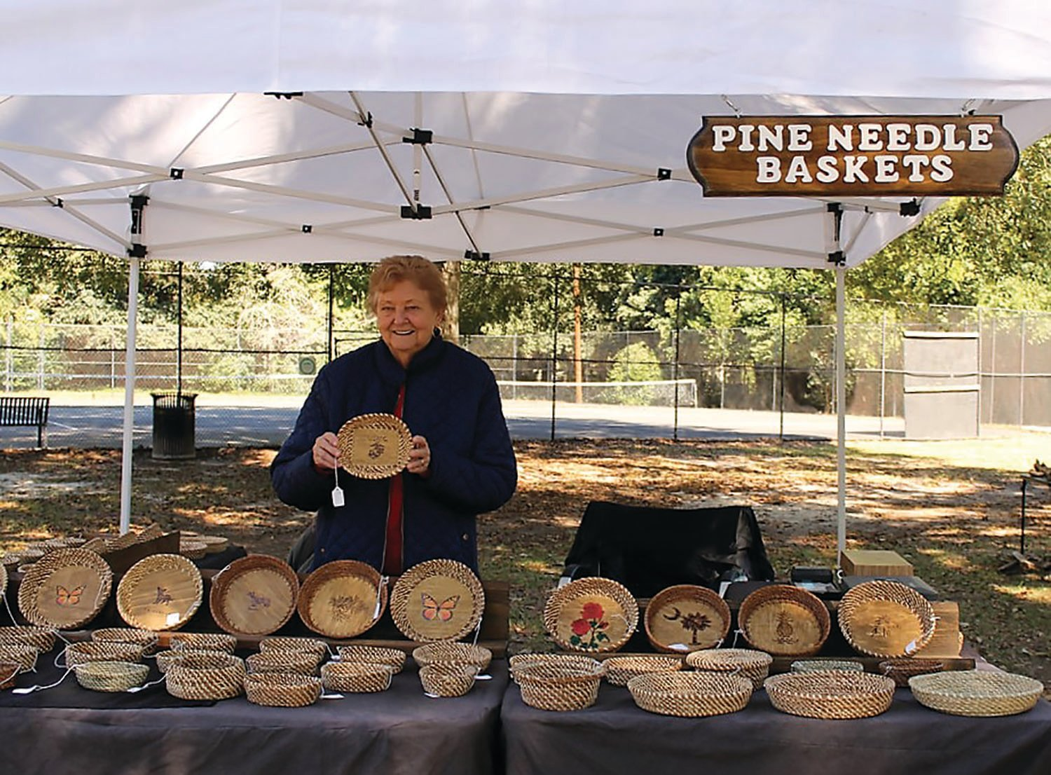 PHOTOS PROVIDED  Penelope Carter, a perennial participant in Art in the Park, will be back with her handwoven pine needle baskets. The outdoor festival and art exhibition will be presented Sept. 19 at Memorial Park. Admission is free.