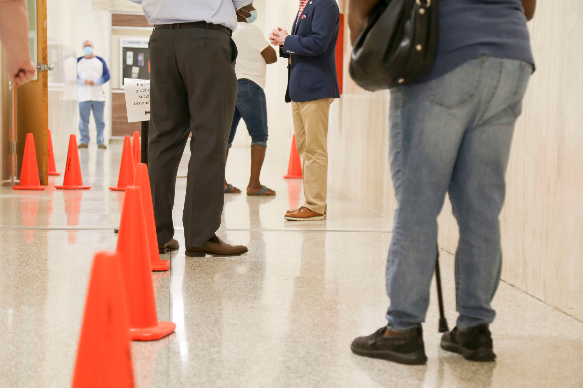 Voters stand in line on Friday, June 5, 2020, at the Sumter County Voter Registration and Elections Office to vote absentee in person. Monday at noon was the filing deadline for city and county races.