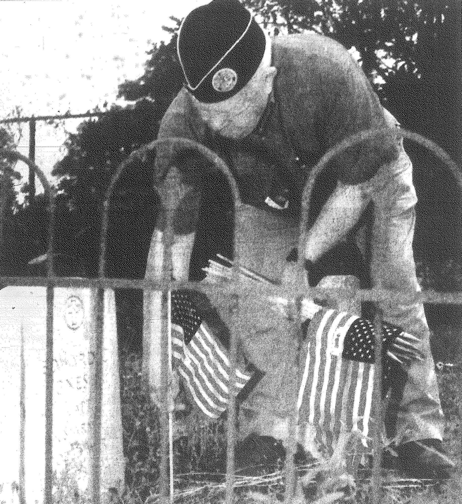 SUMTER ITEM FILE PHOTO  Joe Barwick, flag chairman of the Sumter Veterans Association, places a flag on a veteran's grave in Walker Cemetery for Memorial Day in 1995.