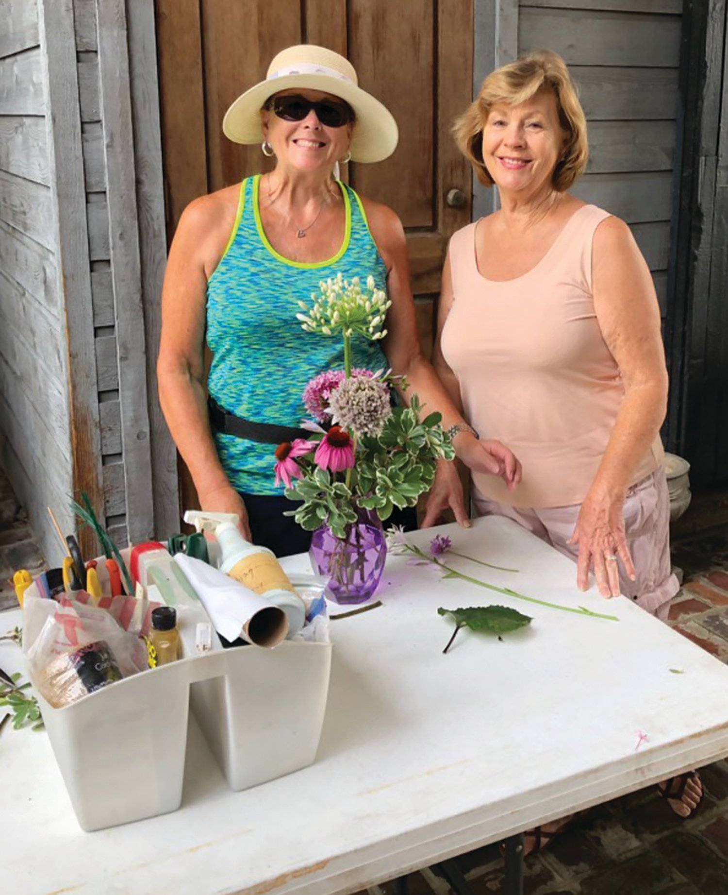 Arlene Ham and Deborah Vincent, members of the Azalea Garden Club, assisted in designing and preparing floral arrangements. The delivery is an annual community beautification project that the club hosts as part of National Garden Club Week.