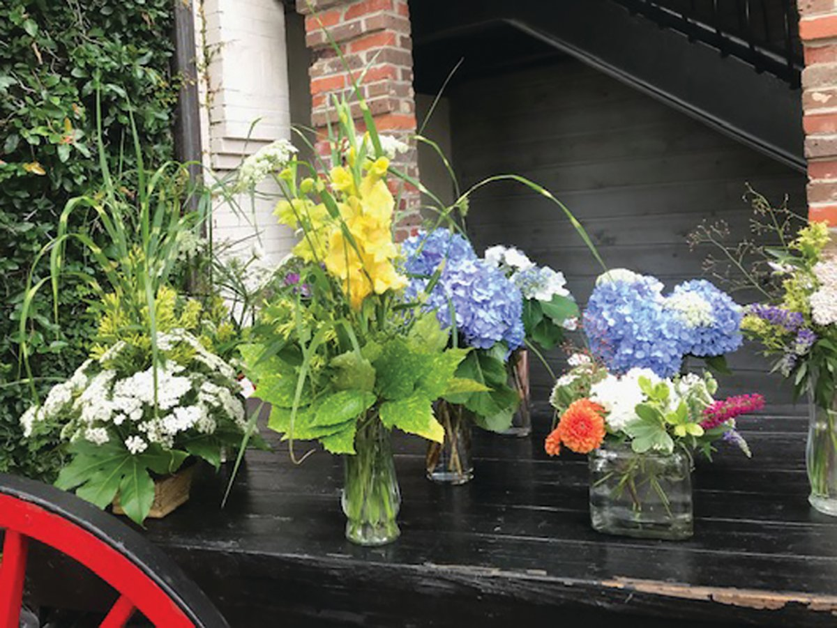 Seen are several of the three dozen flower arrangements that the members of the Azalea Garden Club designed, prepared and delivered to businesses and civic organizations across Manning.