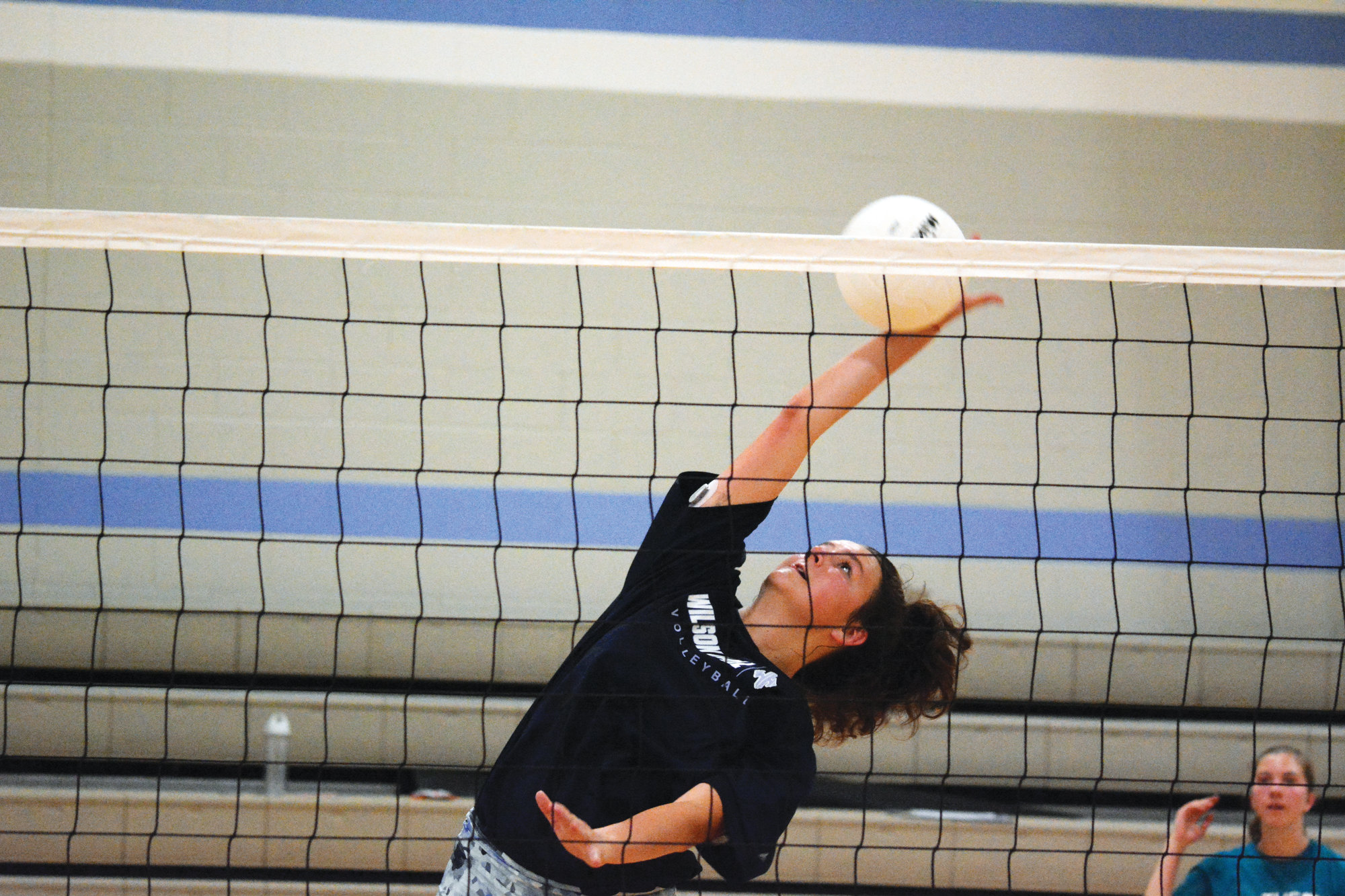 Hayley Champion goes up for a kill during summer workouts on Wednesday.