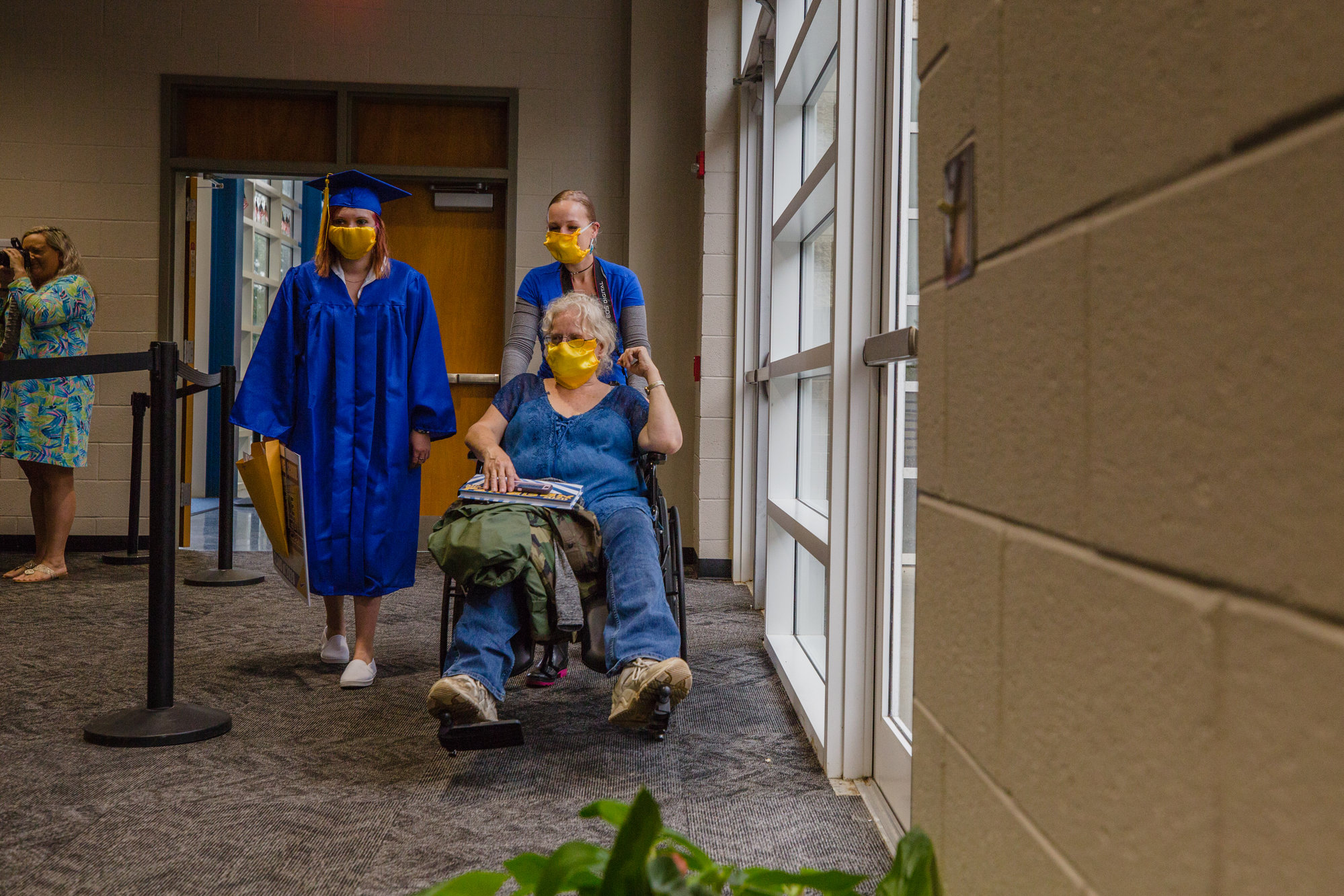 Cheyene McIntosh gets ready to walk at her socially distanced graduation at Sumter High School on May 27, accompanied by Stacey and Dianna McIntosh, her mother and grandmother.