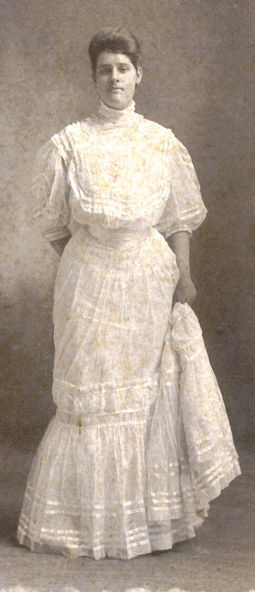 A graduate of Sumter Female Institute is seen in her graduation dress.