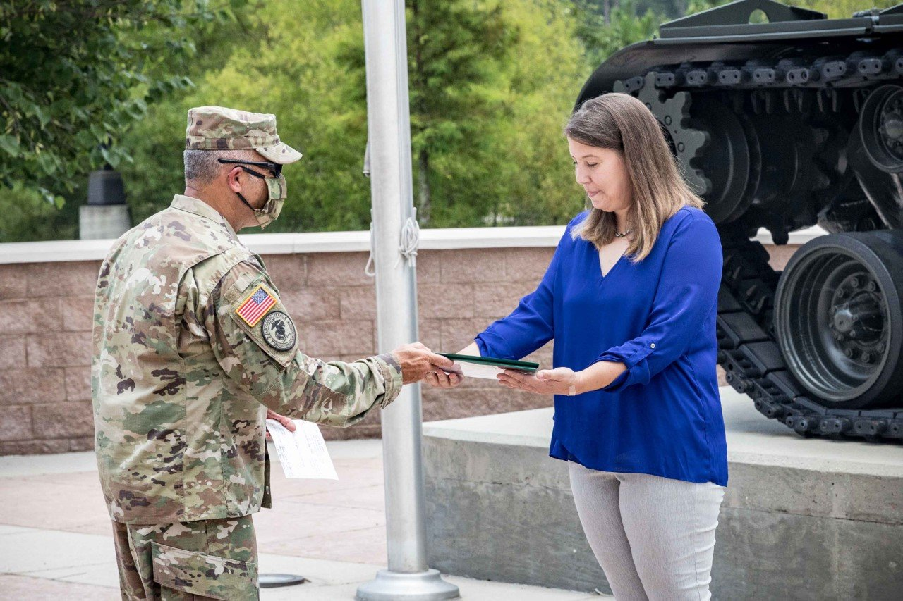 U.S. Army Central Chief of Staff Brig. Gen. Jeffrey Van presented Katrin Galeano with the Meritorious Public Service Medal, the third highest honor the Department of the Army can award to a private citizen in front of the USARCENT Headquarters on July 1.