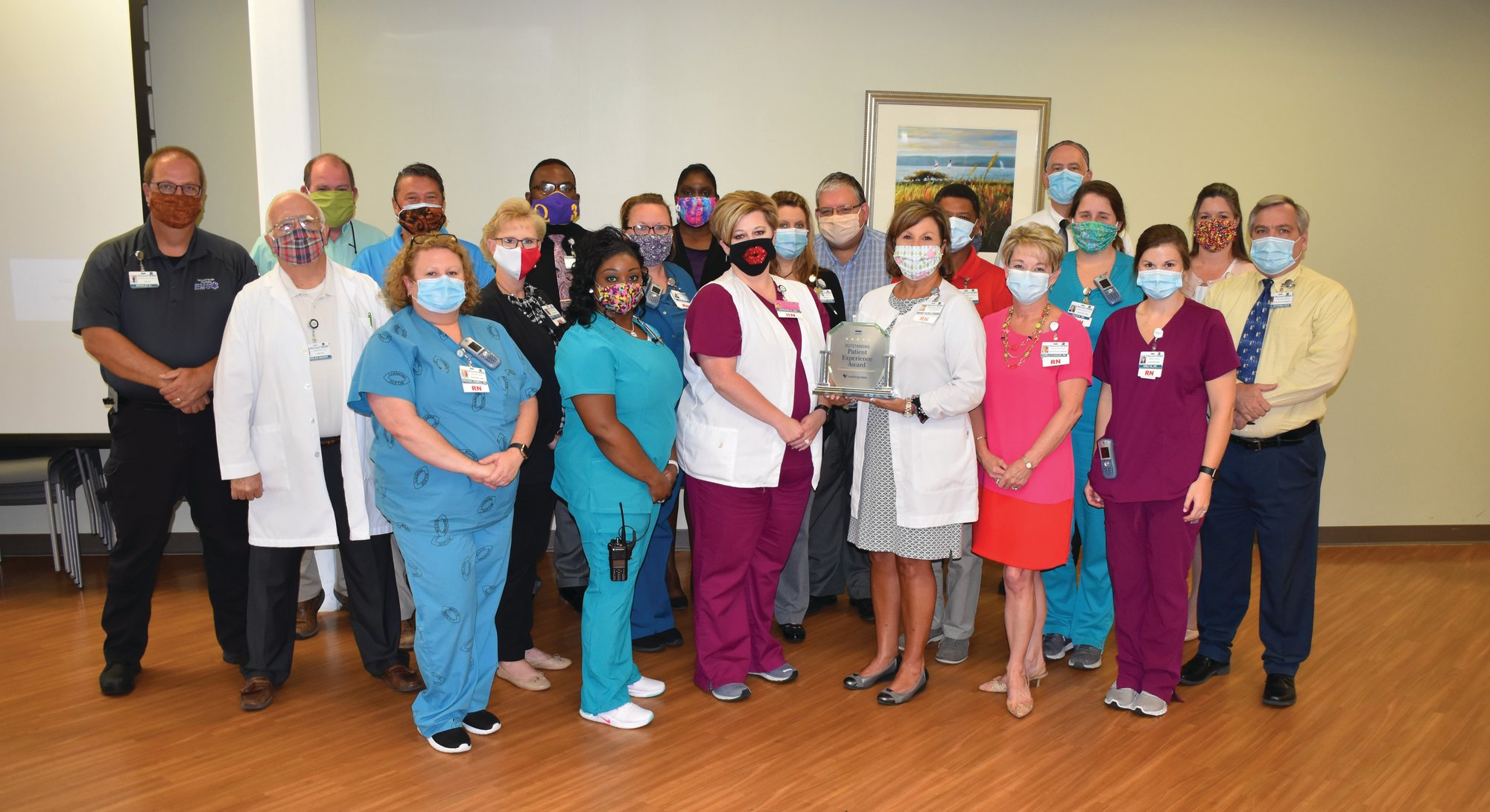 PHOTO PROVIDED  Several of McLeod Health Clarendon's front line staff members and directors are seen with the 2020 Outstanding Patient Experience Award that was given to the hospital on June 6. The award recognized only 424 hospitals across the nation for their outstanding patient experiences.