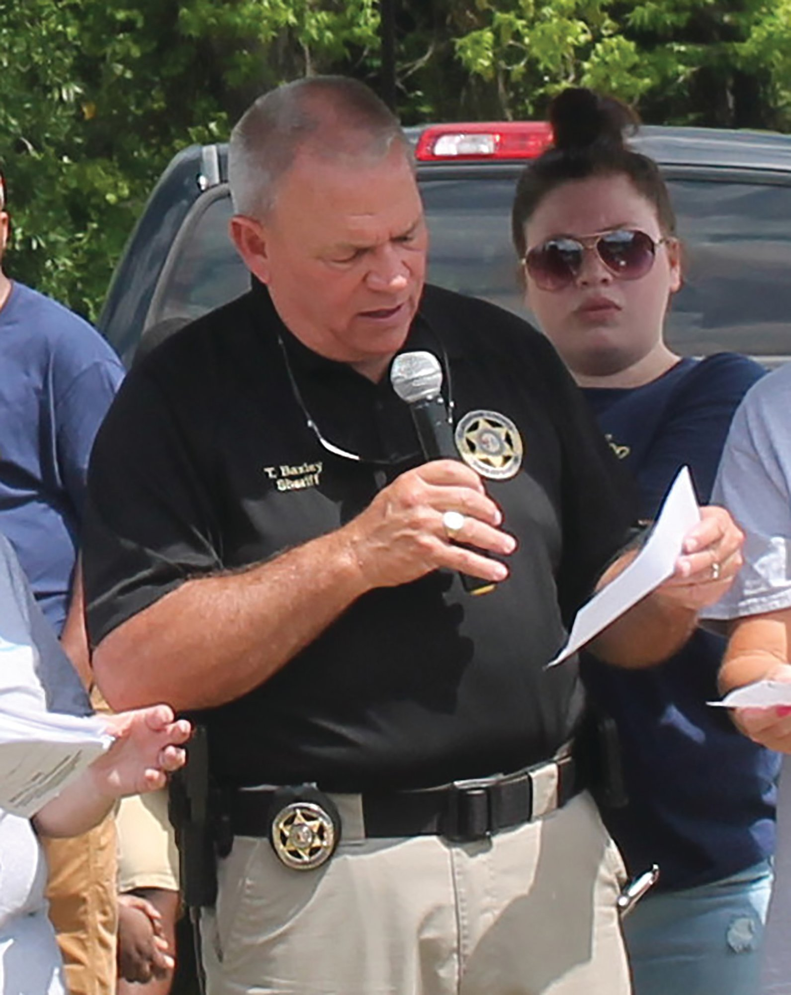 SUMTER ITEM FILE PHOTO Clarendon County Sheriff Tim Baxley reads off the luminary names at the 2019 Clarendon County Cancer Overcovers' Walk.