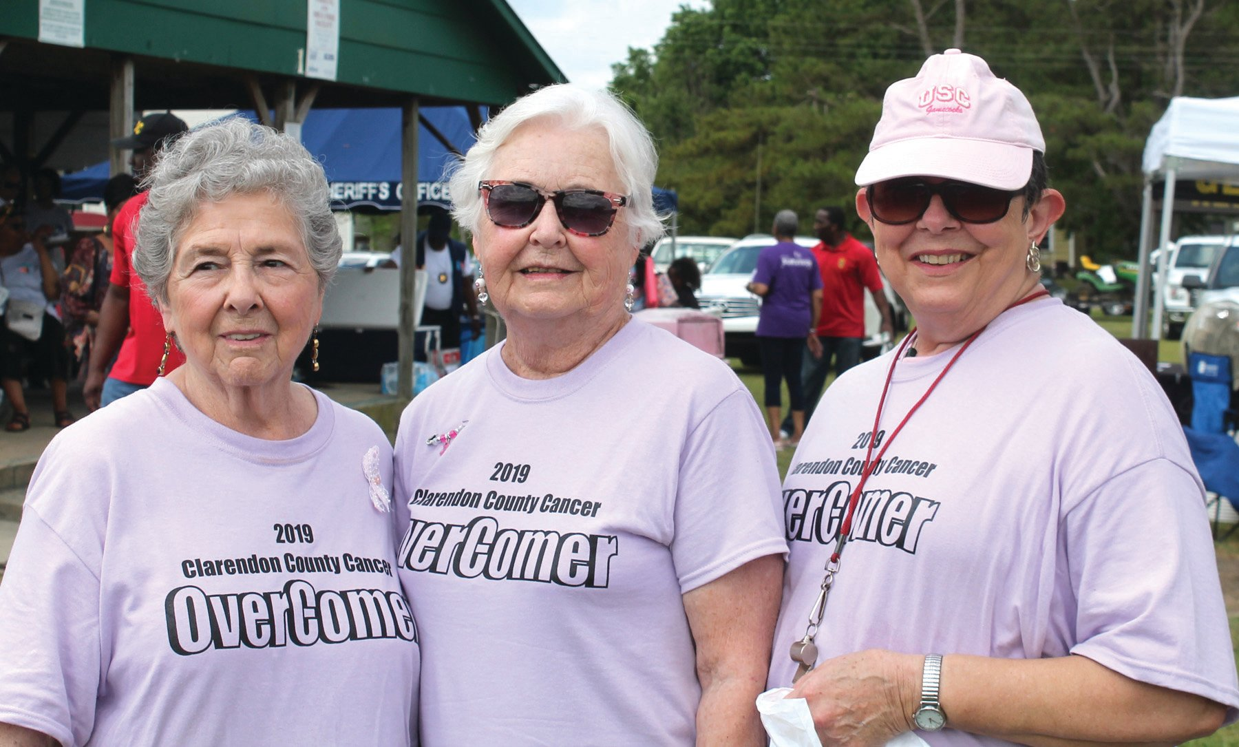 SUMTER ITEM FILE PHOTO Overcomers Sharon Cramer, Annette Browder and Judy Gamble Hooks are shown wearing their FREE overcomer shirts at the 2019 Clarendon County Cancer OverComers' Walk.  OverComers' T-shirts will be free again this year.  To register, call Sgt. Annett Smith with the Clarendon County Sheriff's Office at (803) 460-3976.