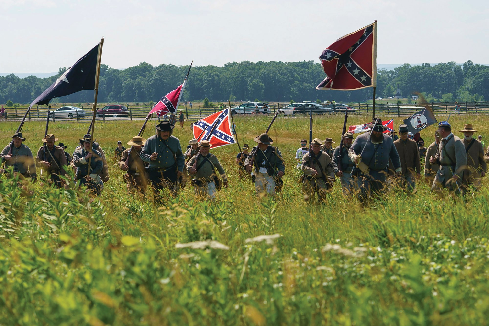 Civil War reenactors march with Confederate battle flags in a recent reenactment of Pickett's Charge at Gettysburg National Military Park in Gettysburg, Pennsylvania. The banner, with its red field and blue X design, is the best known of the flags of the Confederacy, but the short-lived rebel nation also had other flags.