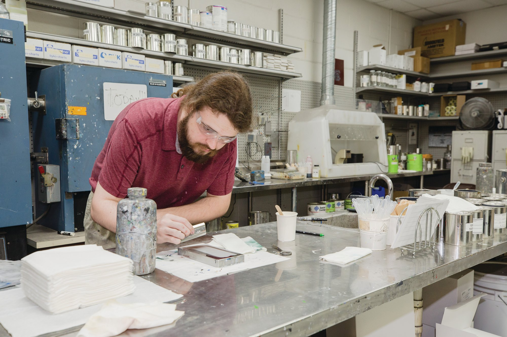 Sumter Coatings' research chemist William Schreiber works in the manufacturer's research and development lab recently. Sumter Coatings made hand sanitizer with an FDA-approved formula for the local community and its customers.