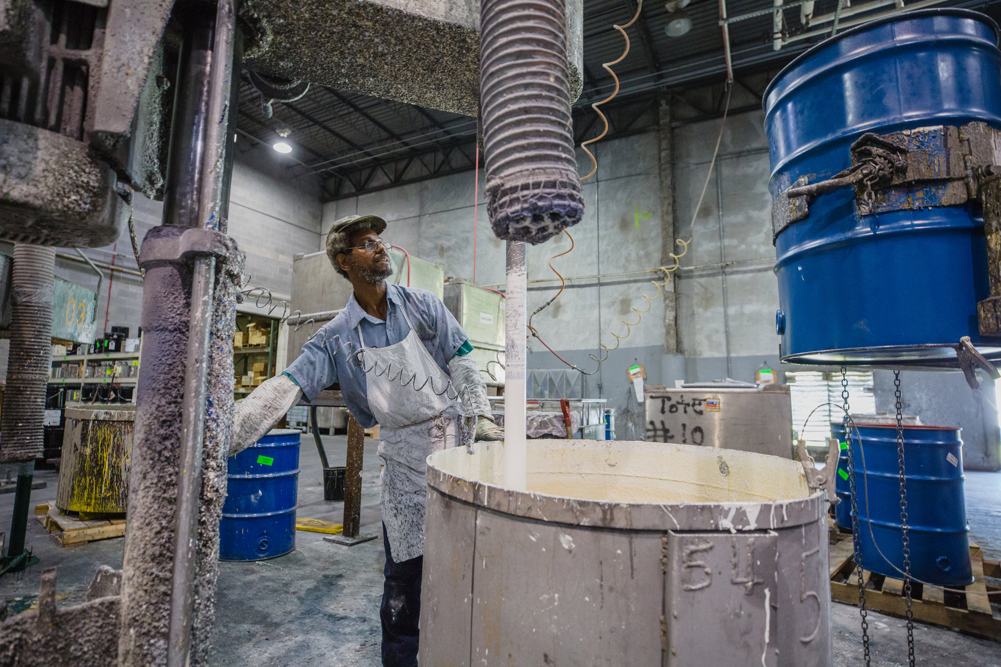 Michael Choice, batchmaker at Sumter Coatings, works to pour a substance on Monday.