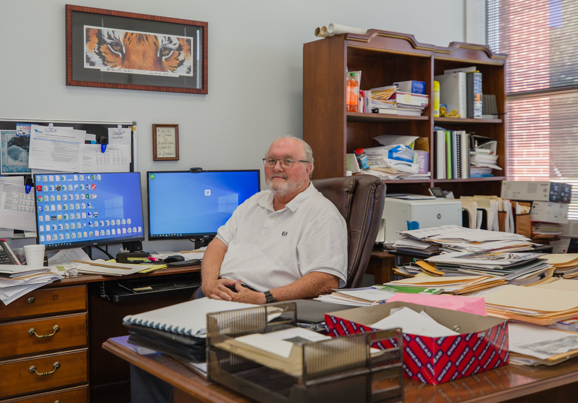 Barry Reynolds, president and CEO of Sumter Coatings at his desk on Monday.