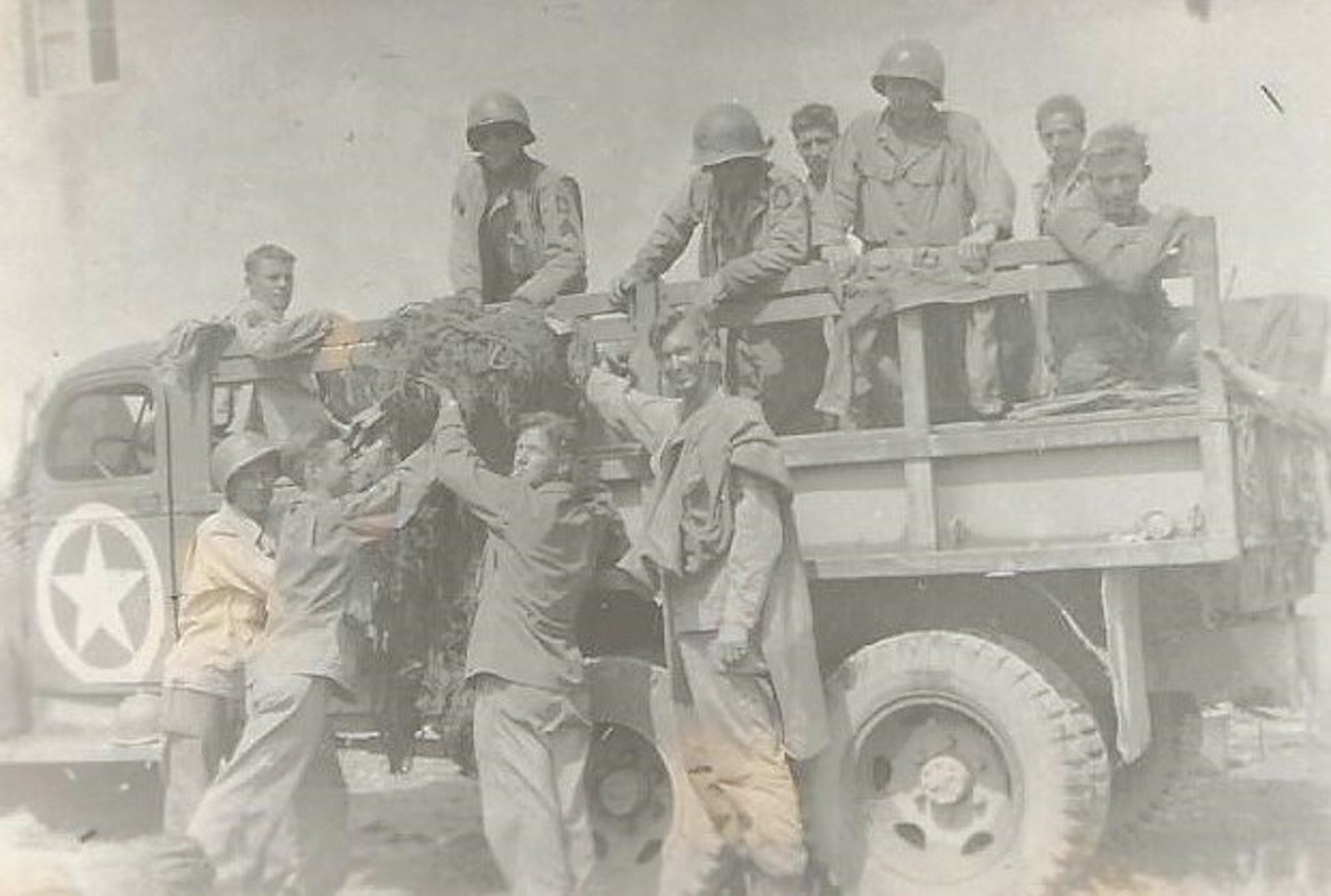 John Henry Thomas and members of his battalion are seen after digging in positions during World War II.