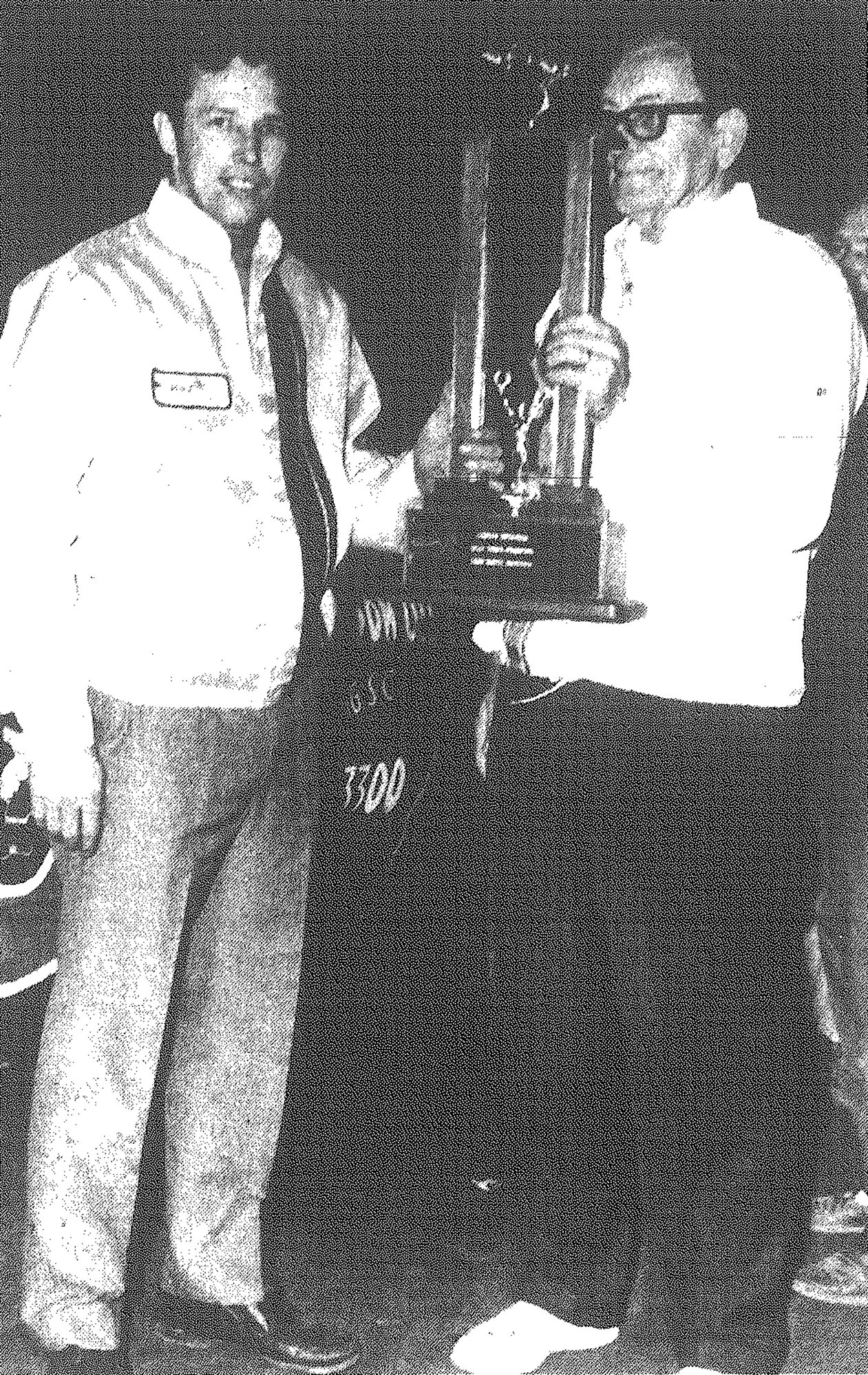 "Slick Gibbons, left, is awarded modified championship at Sumter Speedway by track promoter Pete Kiker on Oct. 20, 1970. Gibbons won 18 races during the 1970 season to become the biggest single-season winner ever at the quarter-mile oval. The Manning veteran earned more than $3,500 for his efforts. Edward Guy ""Slick"" Gibbons died July 18, 2020, at age 77."