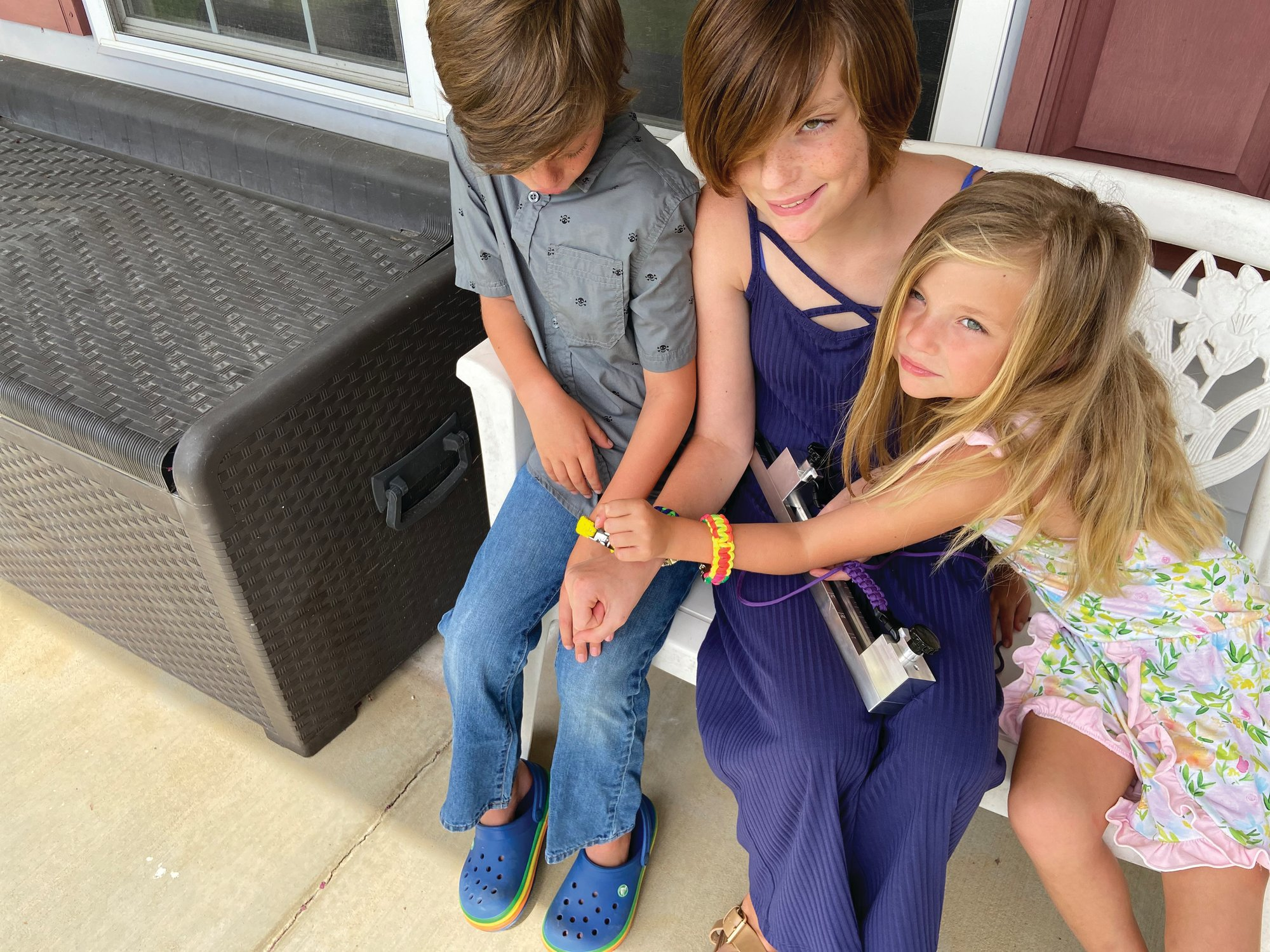 Lynzie's brother Tripp and her sister Kora join her to show off their paracord bracelets, all made by Lynzie.