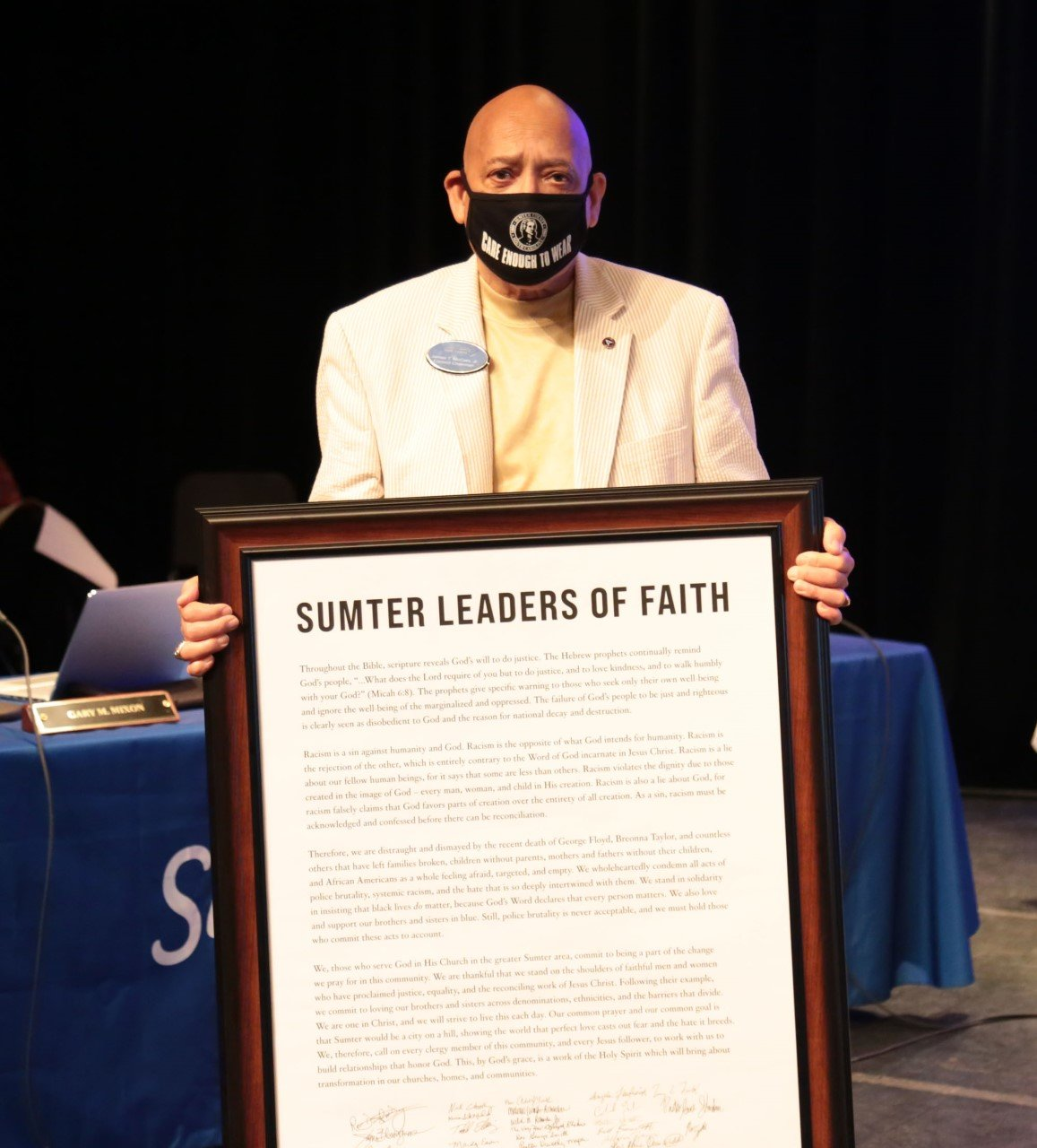 Members of the Sumter Ministerial Alliance presented a framed statement to Sumter County Council Chairman James T. McCain Jr. during council's meeting at Patriot Hall. The Alliance represents 68 Pastors in Sumter County and the statement shows their solidarity against racism. McCain accepted on behalf of Sumter County Council.