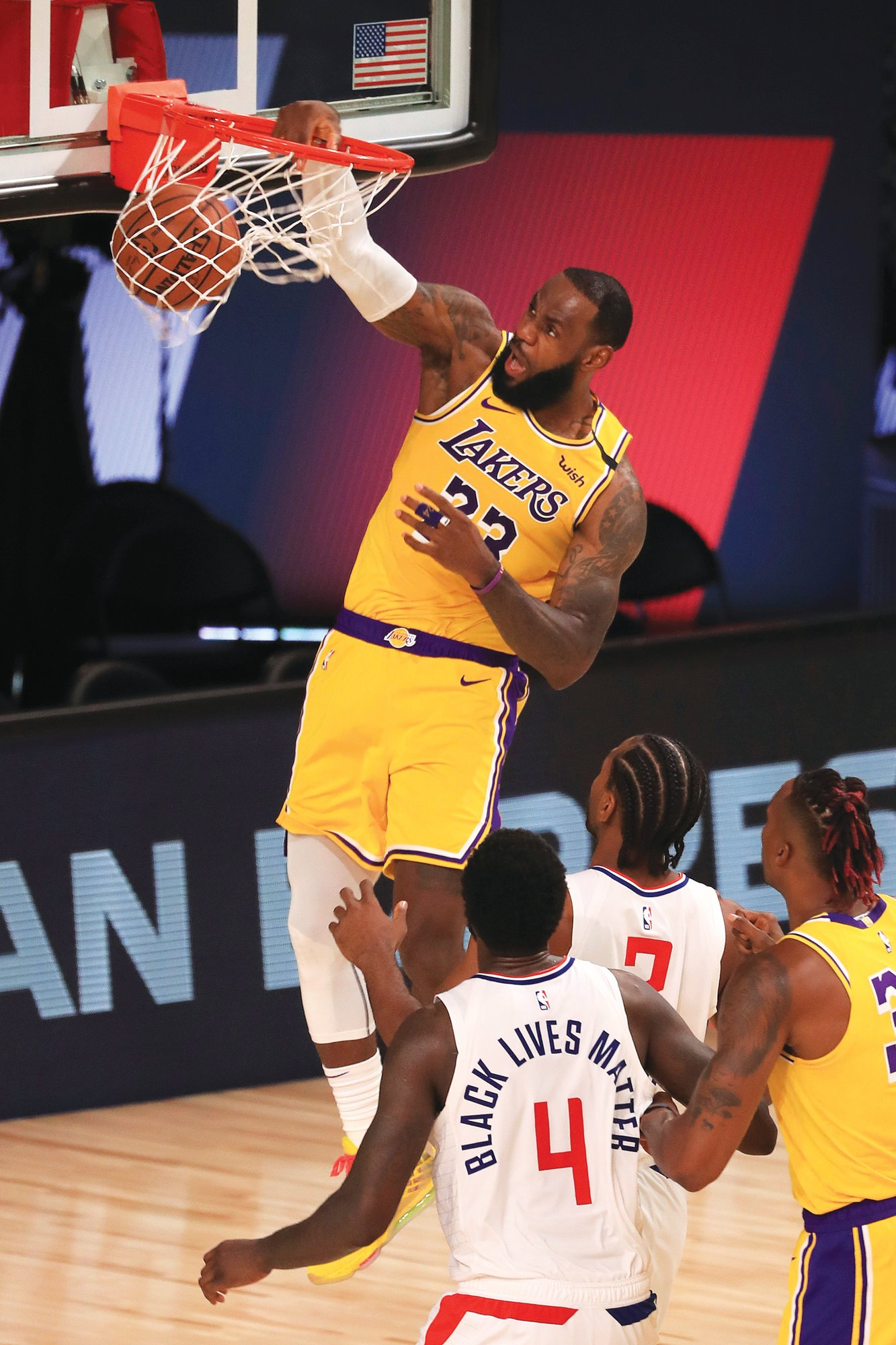 Los Angeles Laker LeBron James, top, dunks against the Los Angeles Clippers during the Lakers' 103-101 win on Thursday in Lake Buena Vista, Florida.