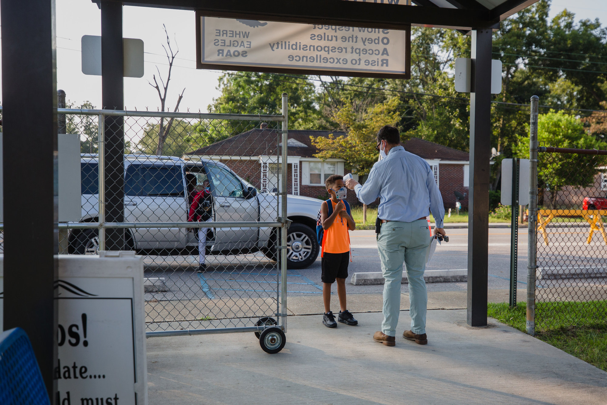 Students are welcomed to Willow Drive Elementary School to participate in LEAP days on Thursday, with temperatures checked daily before entering the building.