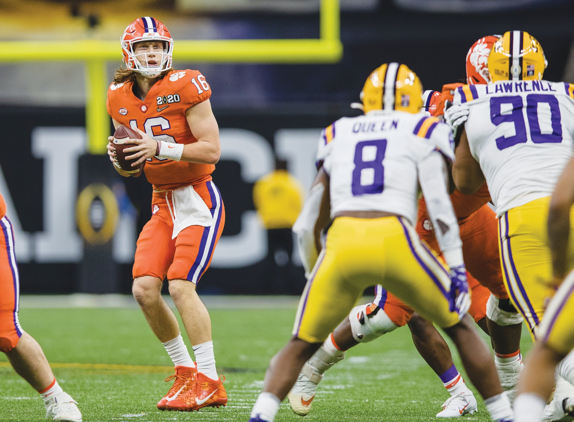 Clemson quarterback Trevor Lawerence (16) is a preseason All-American this year, along with Tiger running back Travis Etienne.