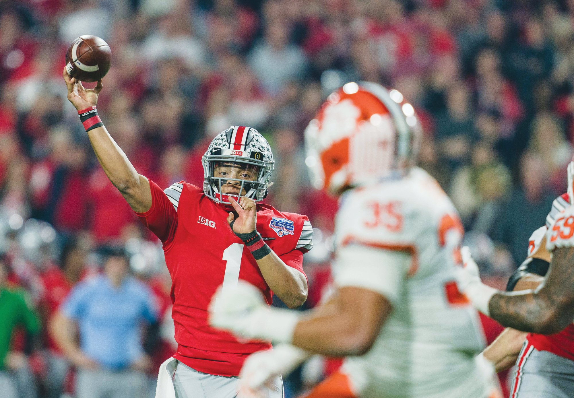 The Big Ten is looking into multiple options to reschedule its football season, opening the door for players like Ohio State quarterback Justin Fields (1) to play some form of college football this season.