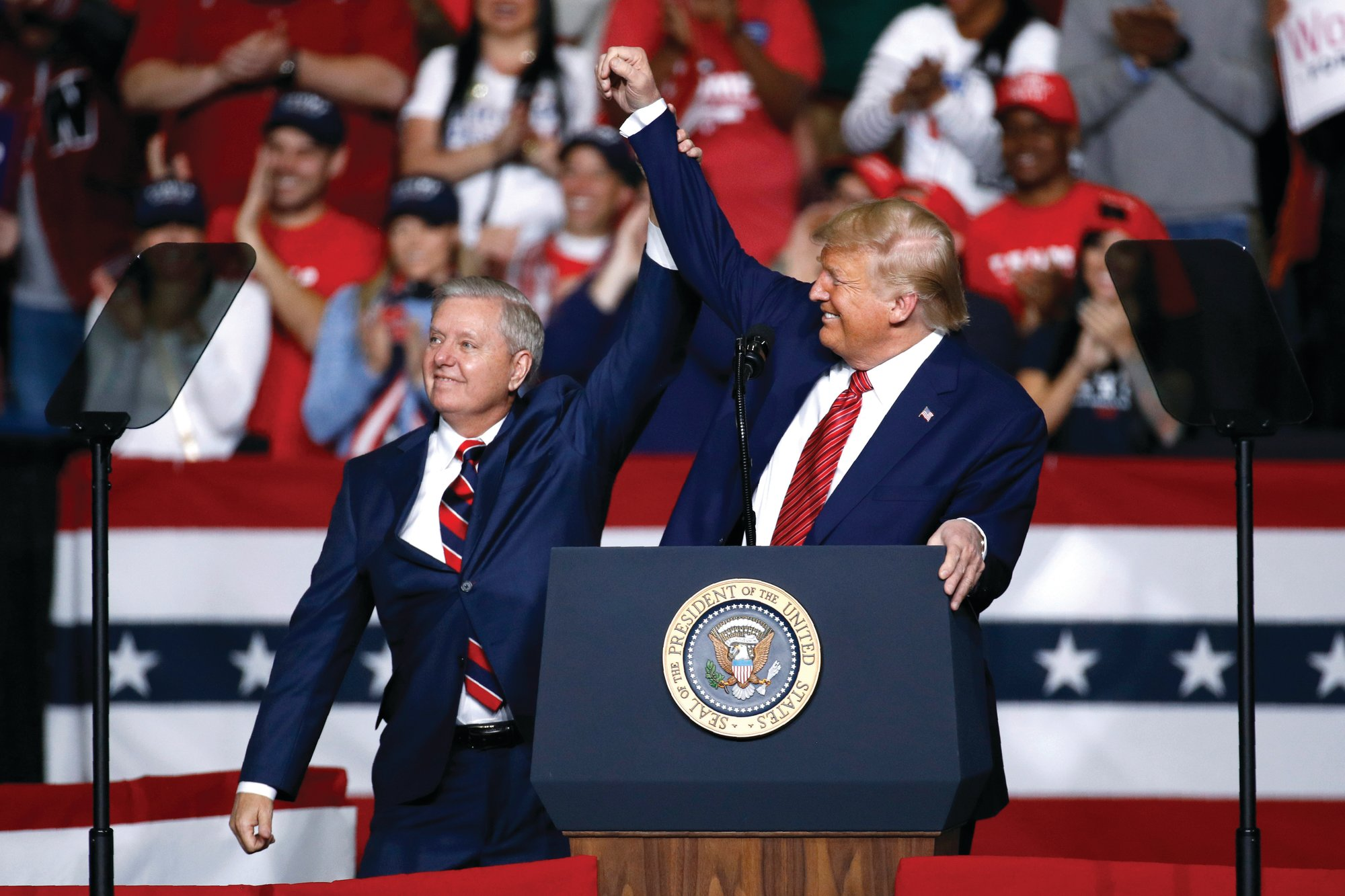 AP FILE PHOTO  Sen. Lindsey Graham, R-S.C., left, stands onstage with President Donald Trump on Feb. 28 during a campaign rally in North Charleston.