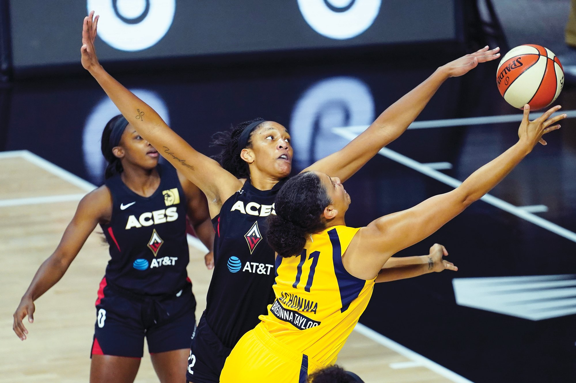 Former South Carolina center A'ja Wilson, center, was named the AP WNBA player of the year after leading the Las Vegas Aces to the top playoff seed this season.
