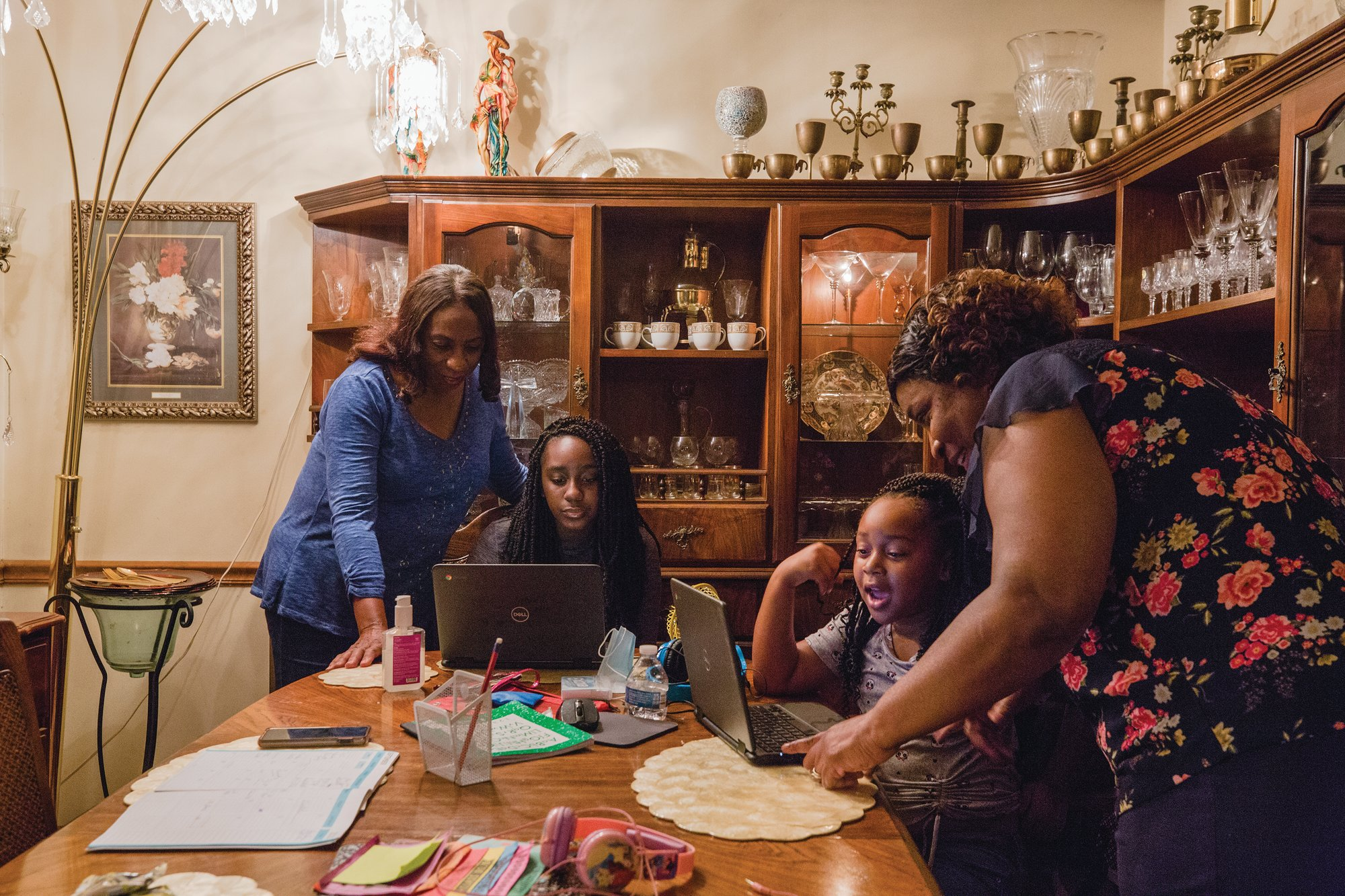 SUMTER ITEM FILE PHOTOAubrielle Burk, a first grader at Millwood Elementary and her sister Gabby Burk, a seventh grader at Bates Middle School, get help from their grandmothers, Gwen Burk and Loretta Brown, on their virtual school assignments at their Gwen's home in 2020.