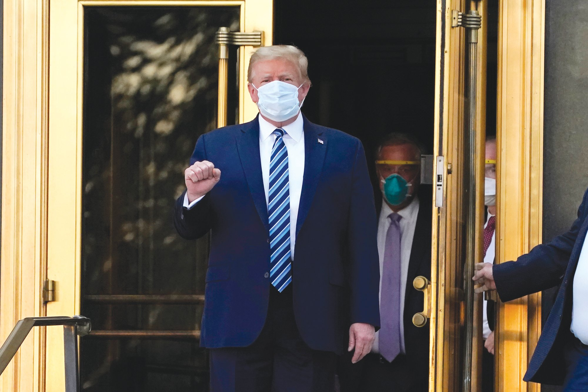 President Donald Trump walks out of Walter Reed National Military Medical Center to return to the White House after receiving treatments for COVID-19 on Monday, Oct. 5, 2020, in Bethesda, Maryland.
