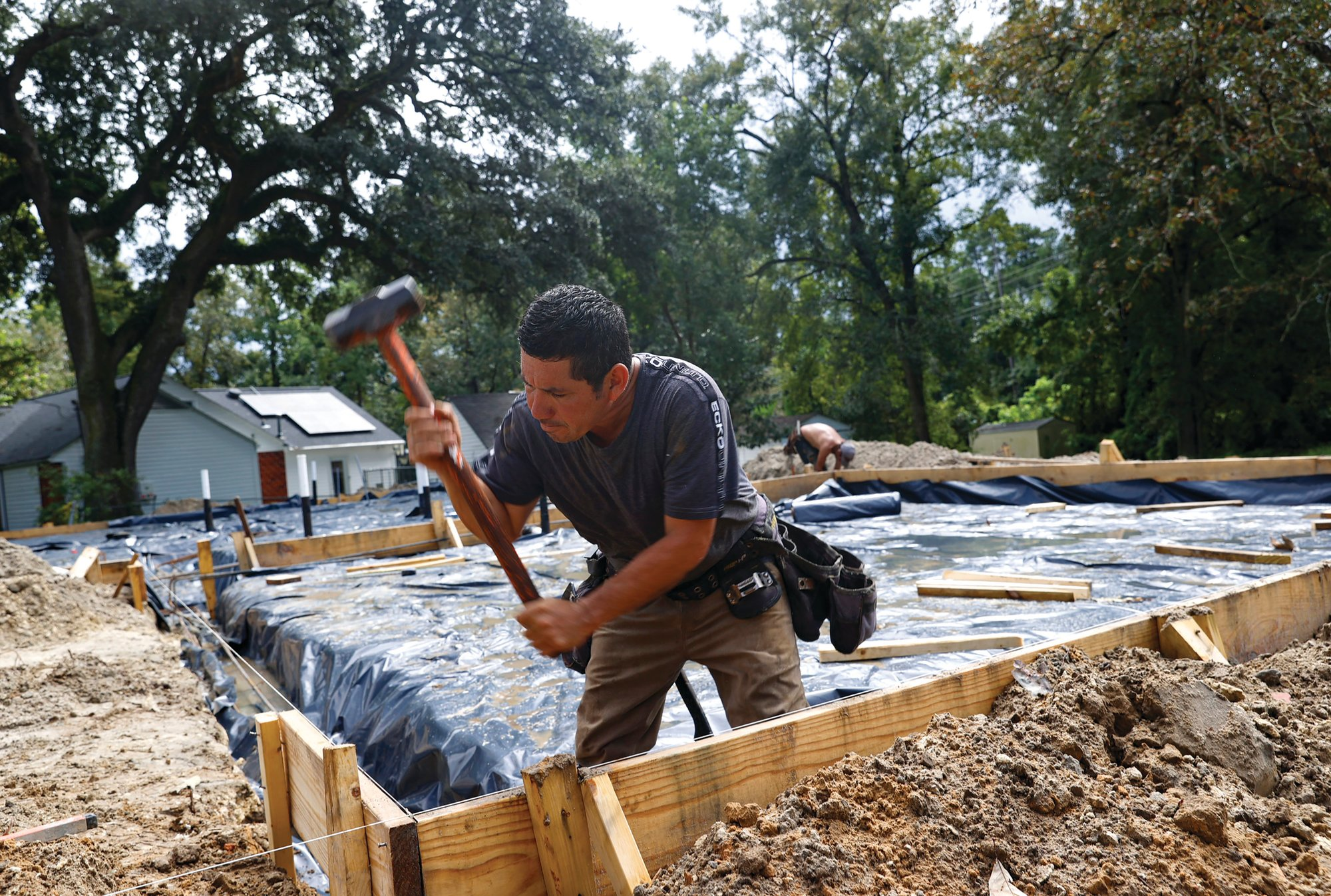Erik Garcia uses a sledgehammer on the foundation of a new house in Hanahan. The city of Hanahan has issued almost as many demolition permits since January as in the past three years combined.