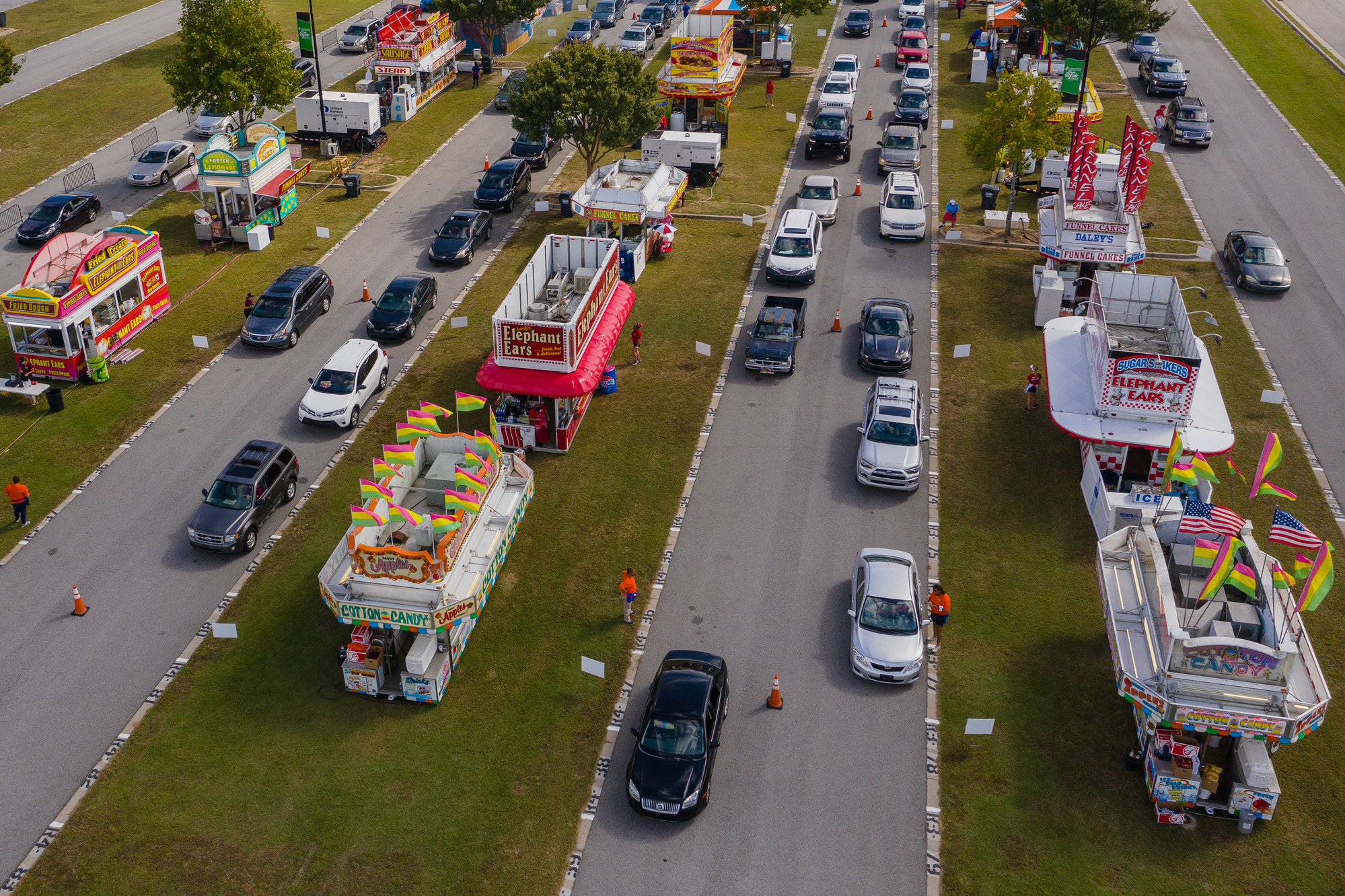 Vehicles drive through the food options at the state fair this week.