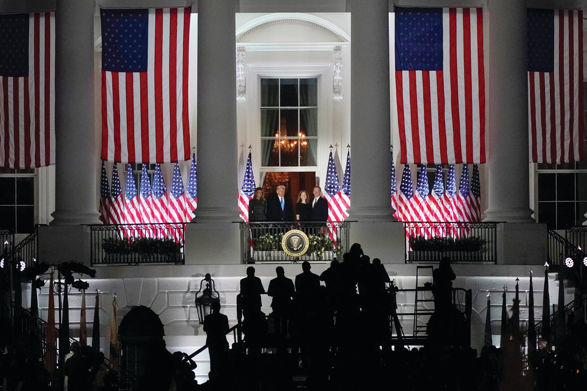 THE ASSOCIATED PRESSFrom left, First Lady Melania Trump, President Donald Trump, Judge Amy Coney Barrett, and her husband, Jesse Barrett, stand on the Blue Room Balcony after Supreme Court Justice Clarence Thomas administered the Constitutional Oath on the South Lawn of the White House in Washington on Monday night.