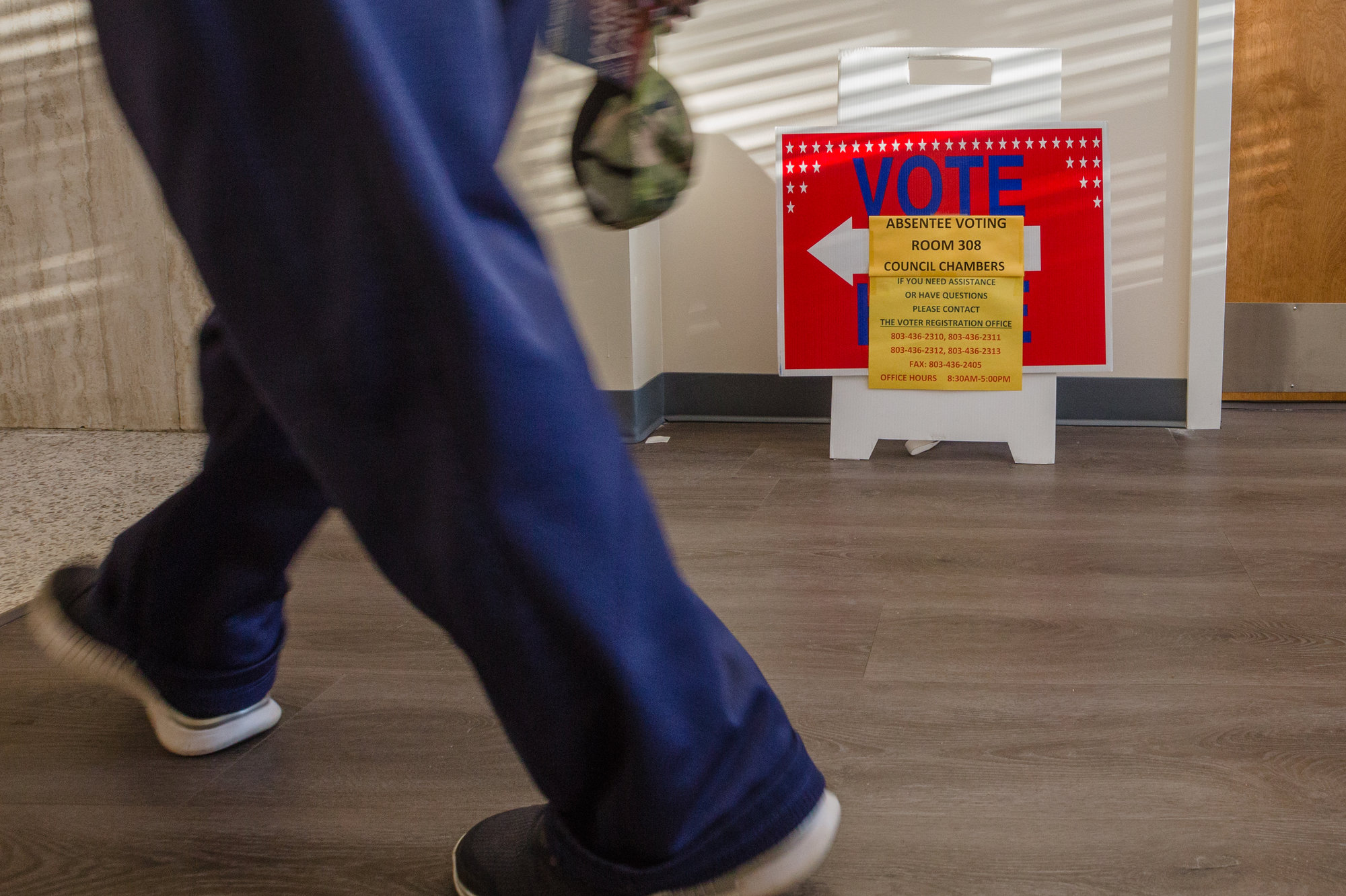 Voting signs are seen inside a polling location at the old Sumter County courthouse on Wednesday, Oct. 14.